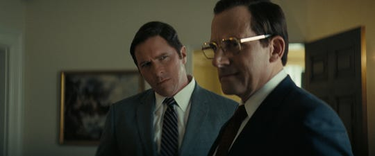 "Congressional intern Dick Cheney (Christian Bale, left) watches as Donald Rumsfeld (Steve Carell) schemes in ""Vice."""