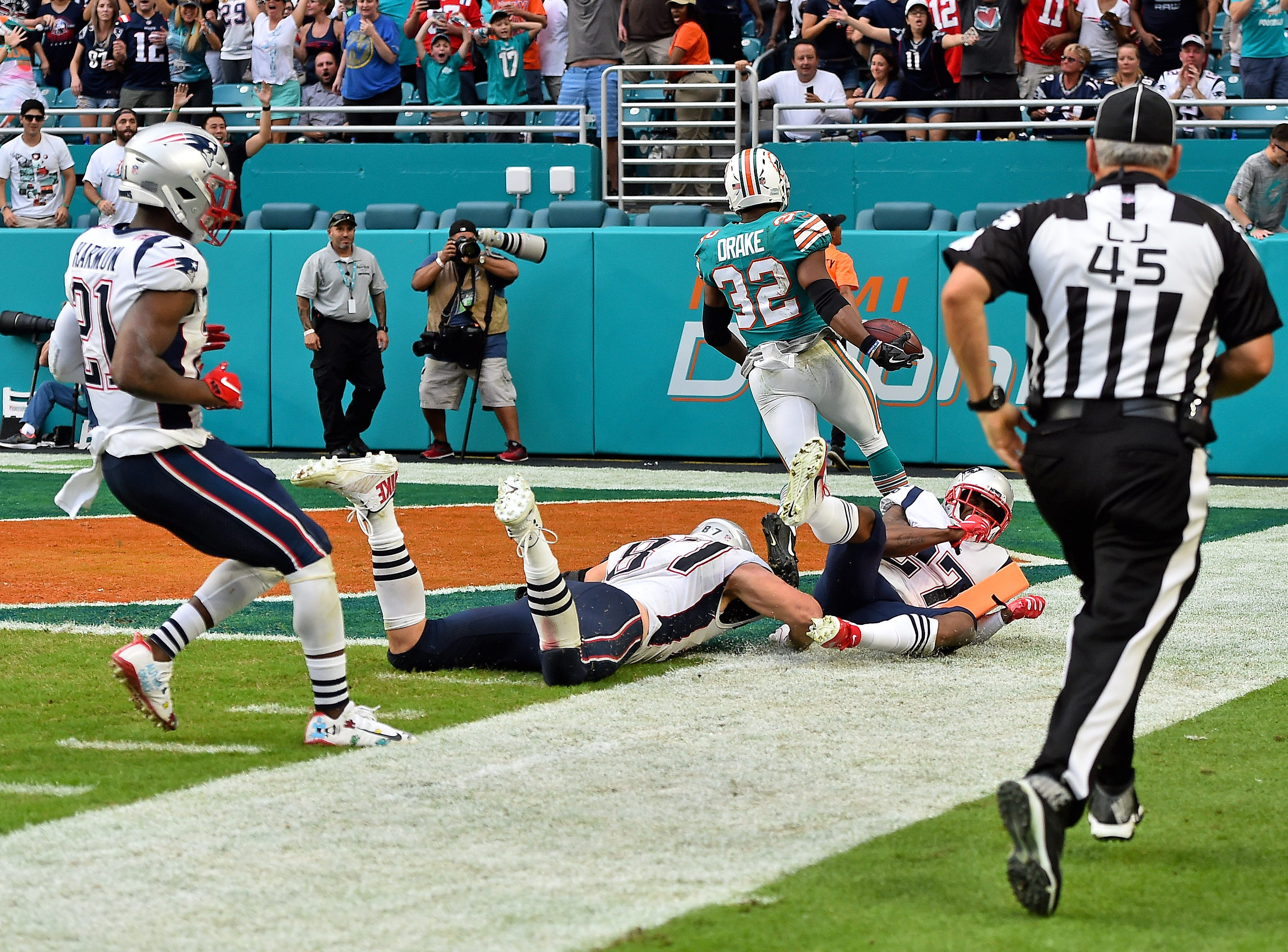 Dec. 9: Miami Dolphins running back Kenyan Drake scores a miraculous, multi-lateral touchdown to defeat the New England Patriots at Hard Rock Stadium.