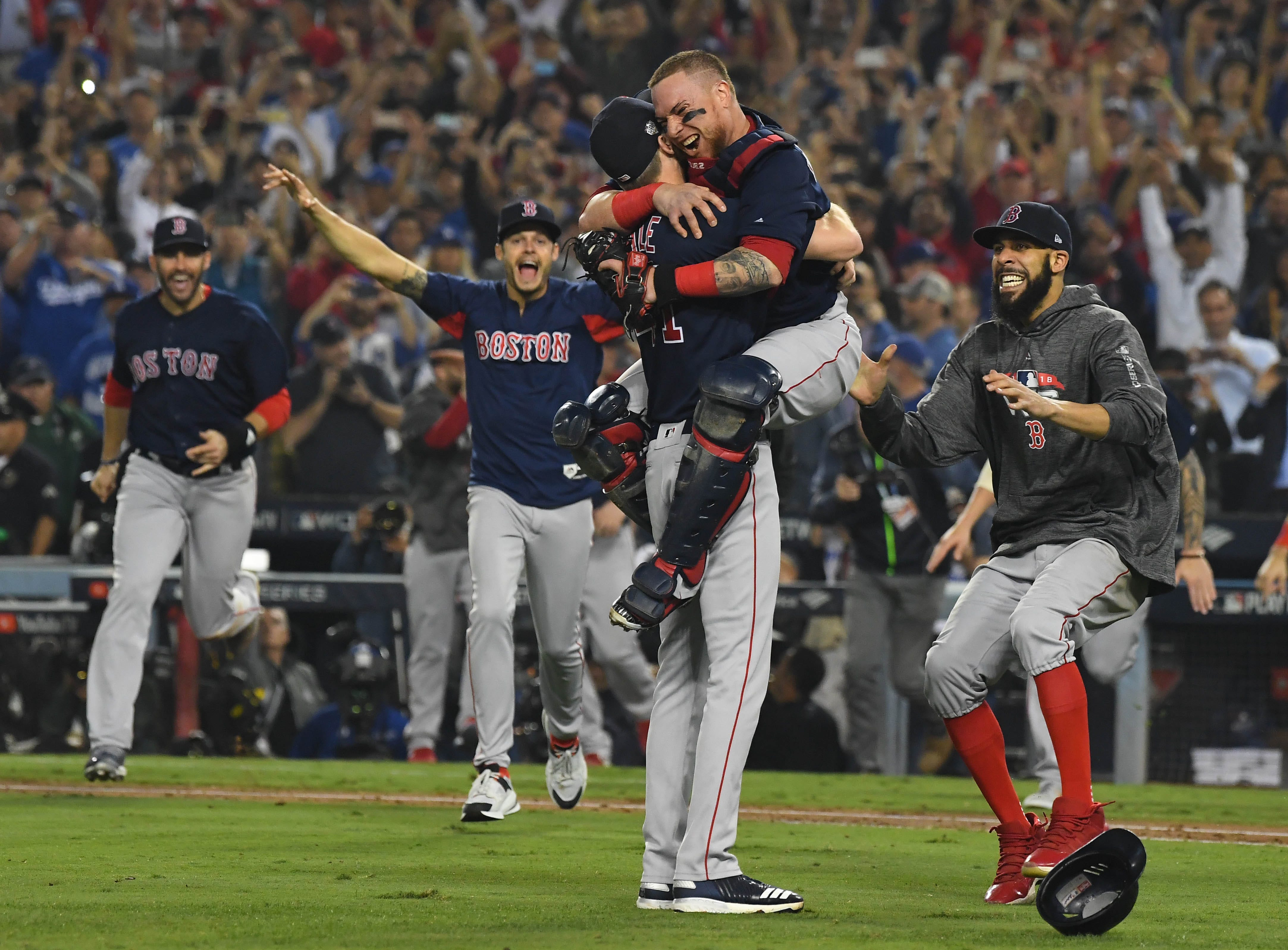 Oct. 28: The Boston Red Sox mob pitcher Chris Sale after beating the Los Angeles Dodgers in Game 5 to win the World Series.