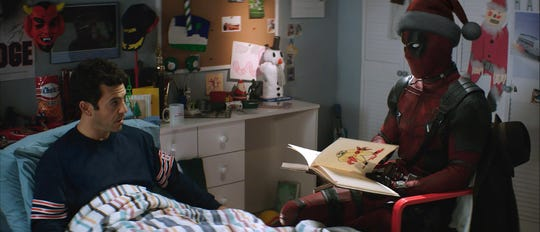 """Fred Savage (left) is a captive audience to Deadpool's (Ryan Reynolds) PG-13 retelling of """"Deadpool 2."""""""