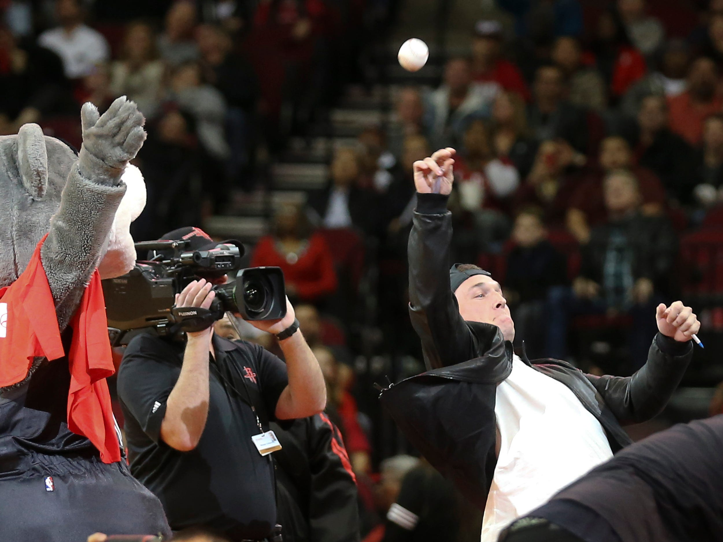 Dec. 11: Astros third baseman Alex Bregman throws a baseball to the fans as the Rockets play the Trail Blazers in the second quarter at Toyota Center.