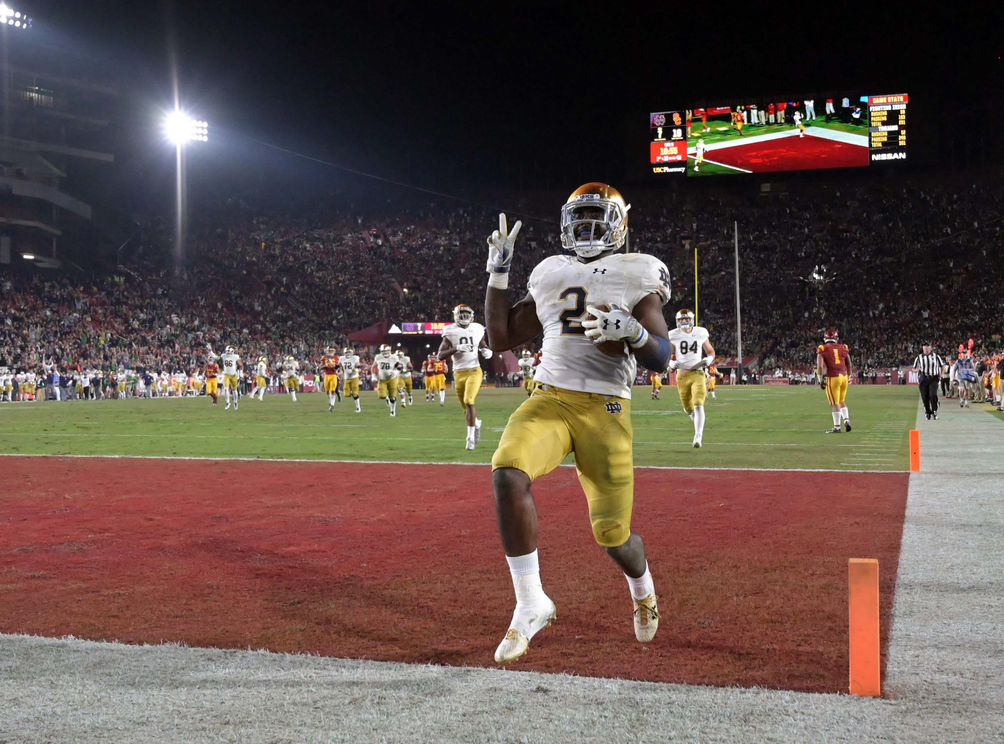 Nov. 24: Notre Dame Fighting Irish running back Dexter Williams celebrates after scoring on a 52-yard touchdown run in the third quarter against the Southern California Trojans at the Los Angeles Memorial Coliseum.