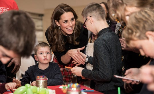 Duchess Kate of Cambridge meets children at Kensington Palace where she and Prince William hosted a Christmas party for families and children of Royal Air Force personnel serving on Cyprus, Dec. 4, 2018.