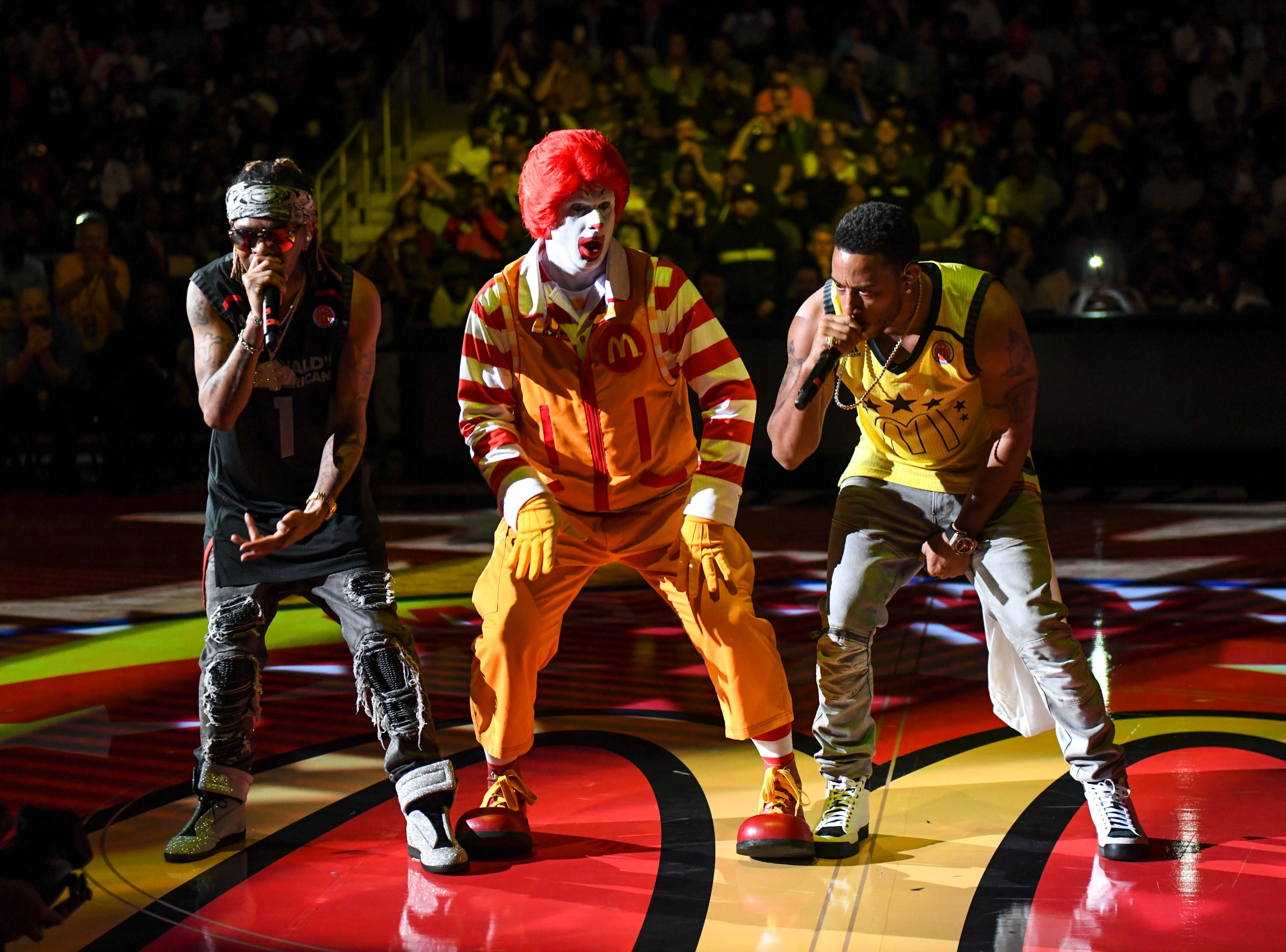 March 28: In an unlikely duo, Ludacris and Ronald McDonald perform together at the 2018 McDonald's All American Games in Atlanta.