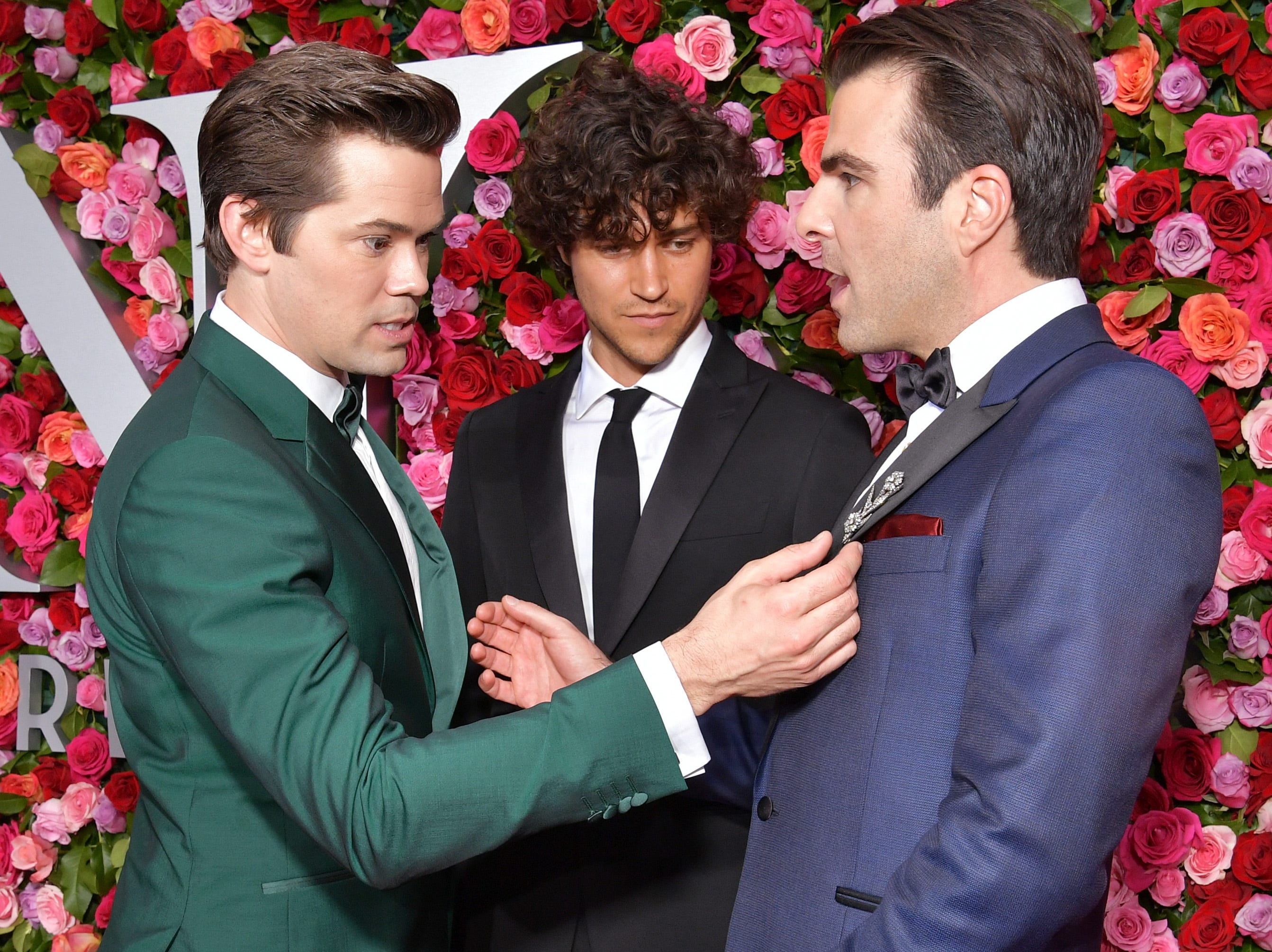 June 10: Andrew Rannells, Miles McMillan and Zachary Quinto check out each others' outfits at the Tony Awards in New York City.