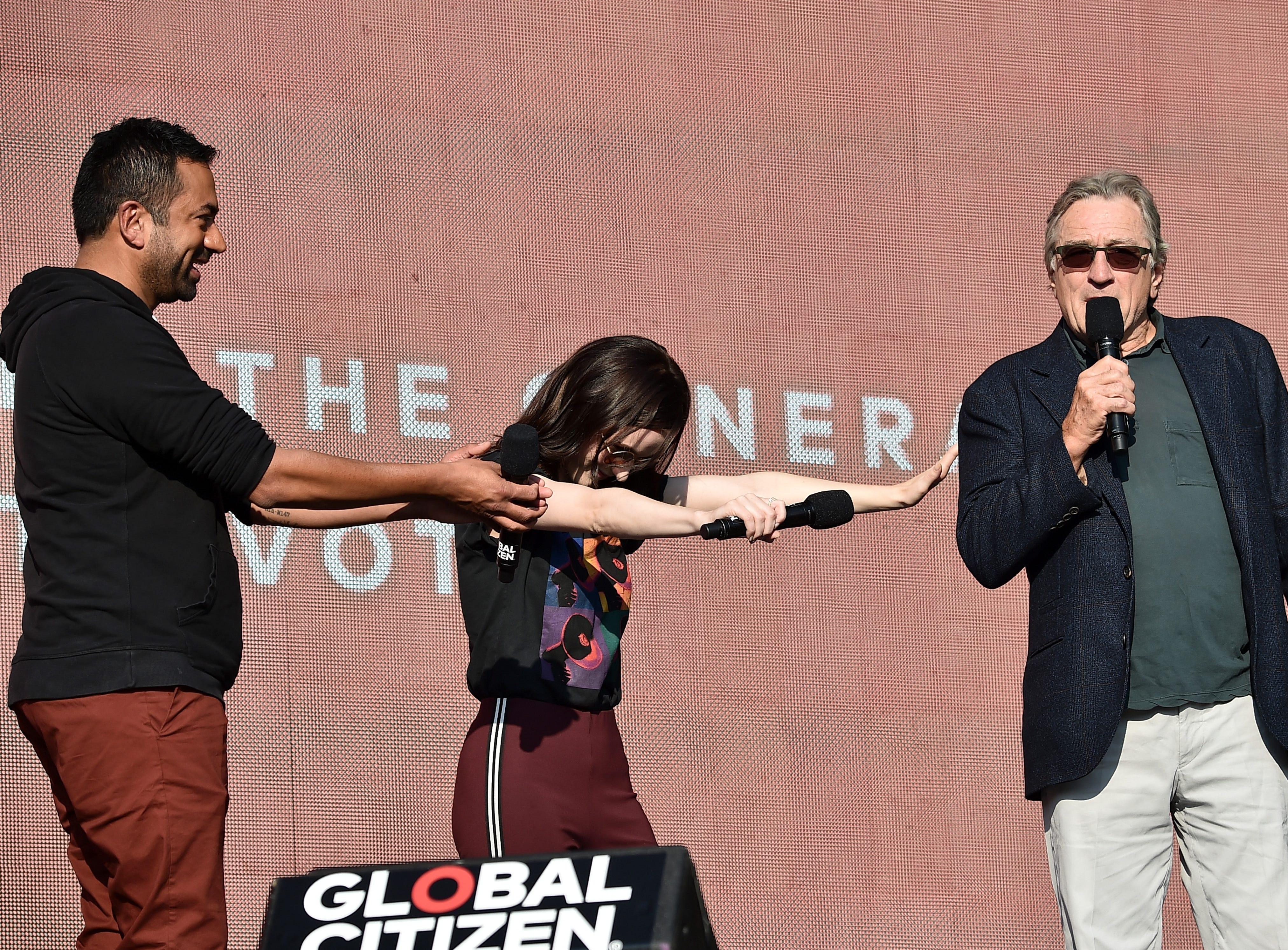 September 29: Kal Penn and Rachel Brosnahan bow down to Robert De Niro onstage during the 2018 Global Citizen Festival in New York City.