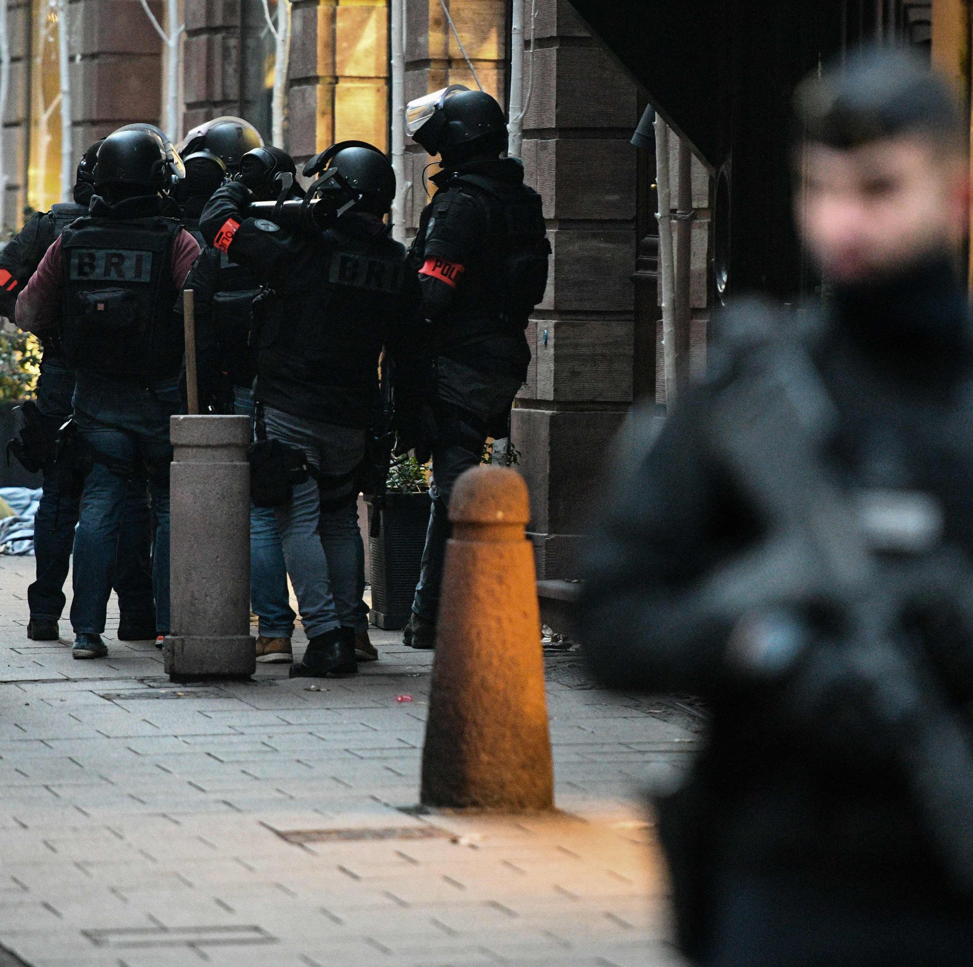 Members of the French special forces BRI (Research and Intervention Brigade -  Brigades de recherche et d'intervention) conduct searches on December 12, 2018 for the gunman who opened fire near a Christmas market in Strasbourg, eastern France, the night before. - Hundreds of security forces were deployed in the hunt for a lone gunman who killed at least three people and wounded a dozen others at the famed Christmas market in Strasbourg, with the French government raising the security alert level and reinforcing border controls.