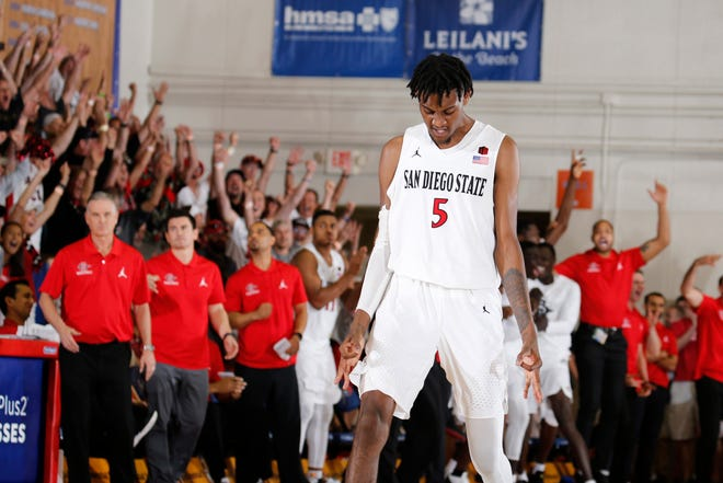 San Diego State forward Jalen McDaniels reacts to making a 3-point shot against Xavier in the 2018 Maui Jim Maui Invitational.