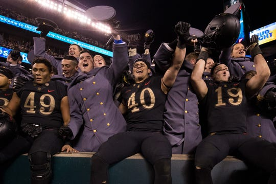 Dec. 8: The Army Black Knights celebrate with cadets after a victory against the Navy Midshipmen at Lincoln Financial Field.