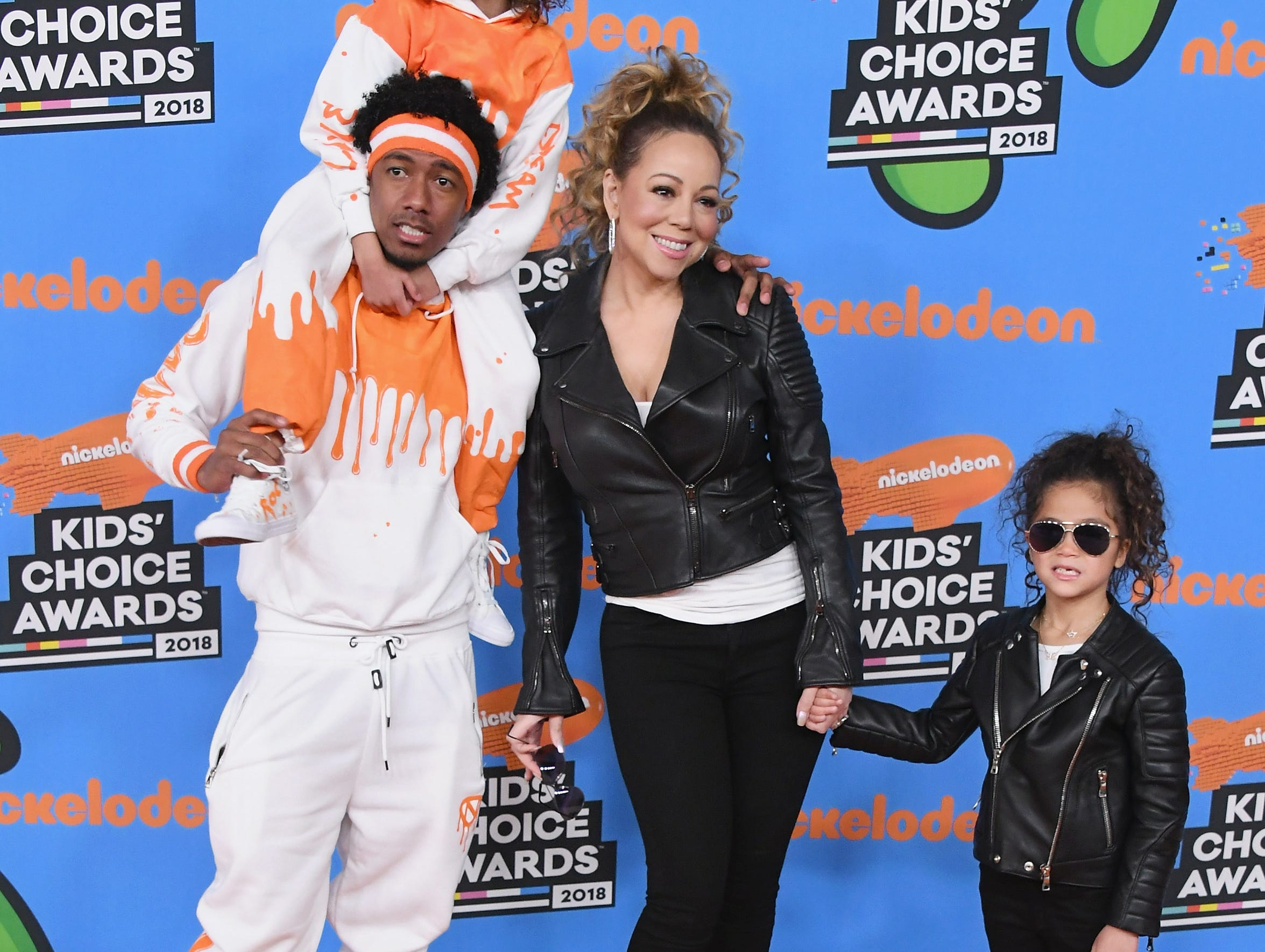 March 24: Co-parenting goals: Nick Cannon and Mariah Carey take their kids, Moroccan and Monroe, to the Kids' Choice Awards in adorable matching outfits.