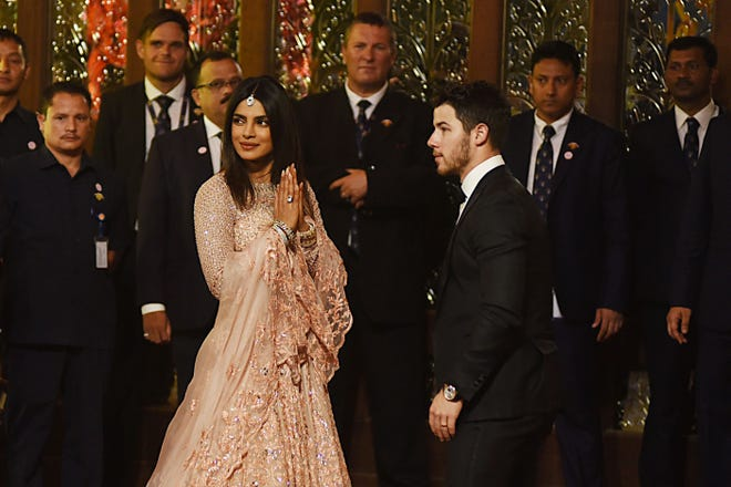 Newlyweds actress Priyanka Chopra and musician Nick Jonas attend the wedding ceremony of Isha Ambani and Anand Piramal in Mumbai.