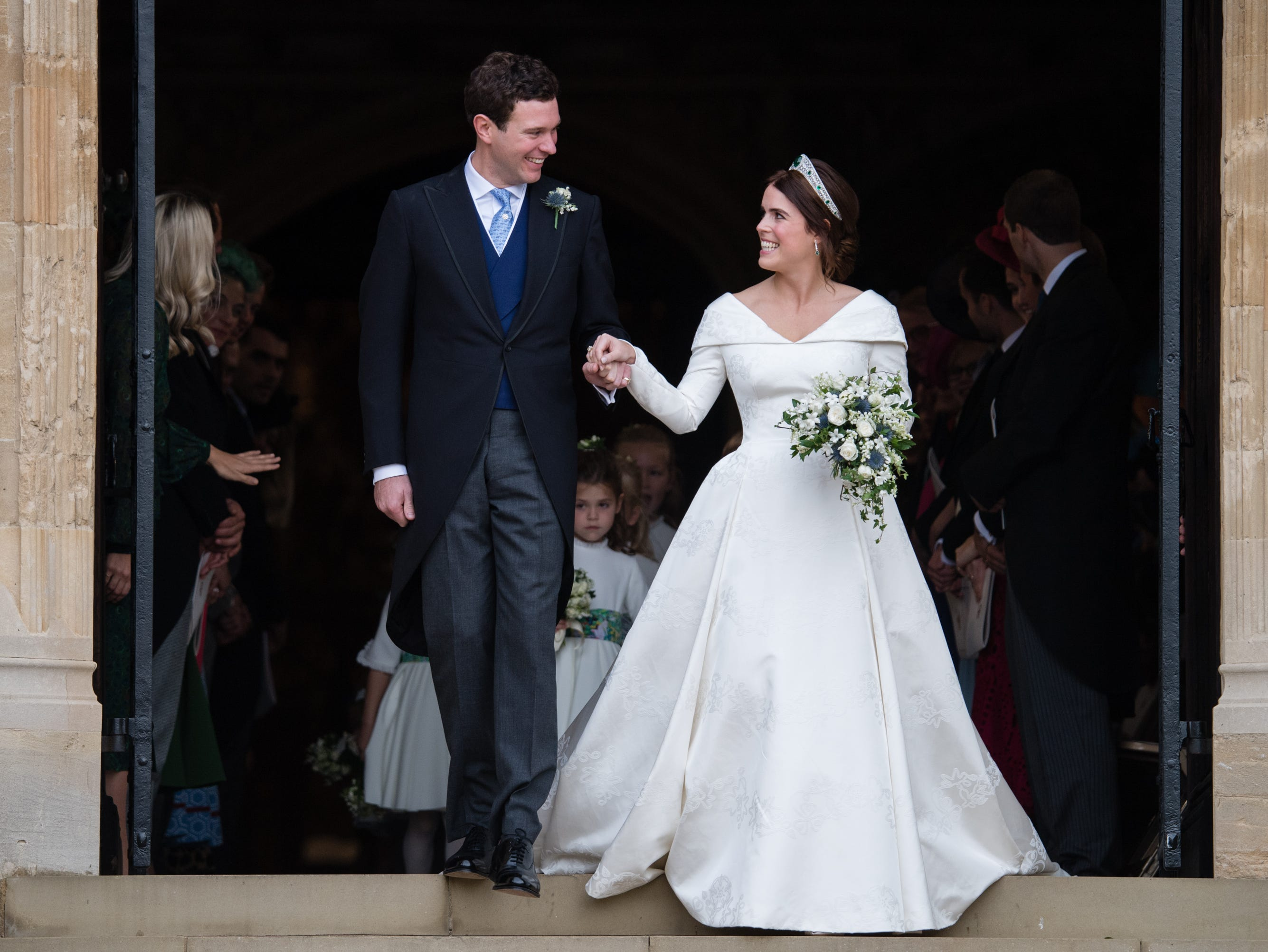 October 12: Princess Eugenie of York and Jack Brooksbank leave St George's Chapel in Windsor Castle following their wedding.