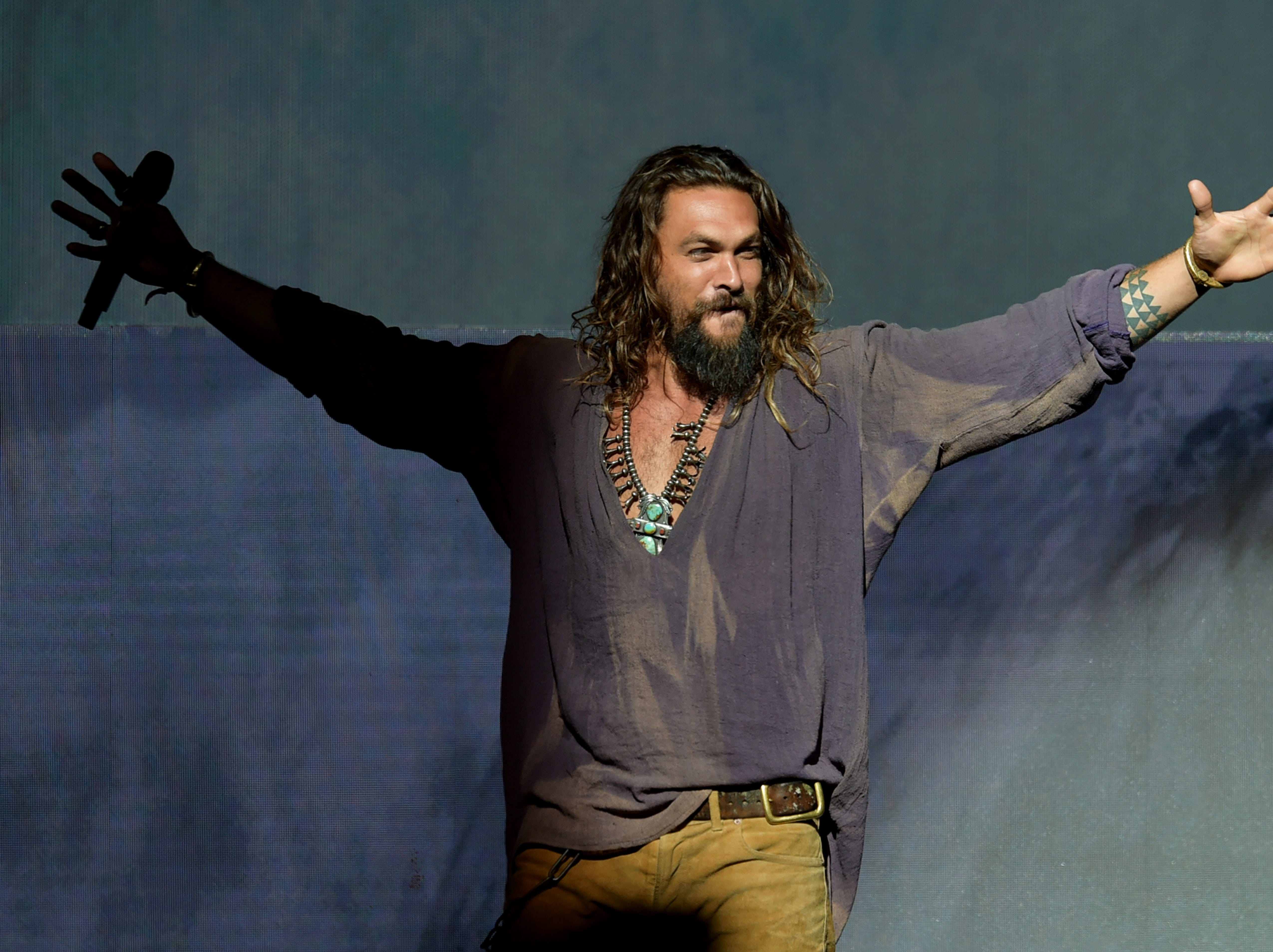 July 21:  Jason Momoa speaks onstage at the Warner Bros. theatrical panel during Comic-Con in San Diego, California.