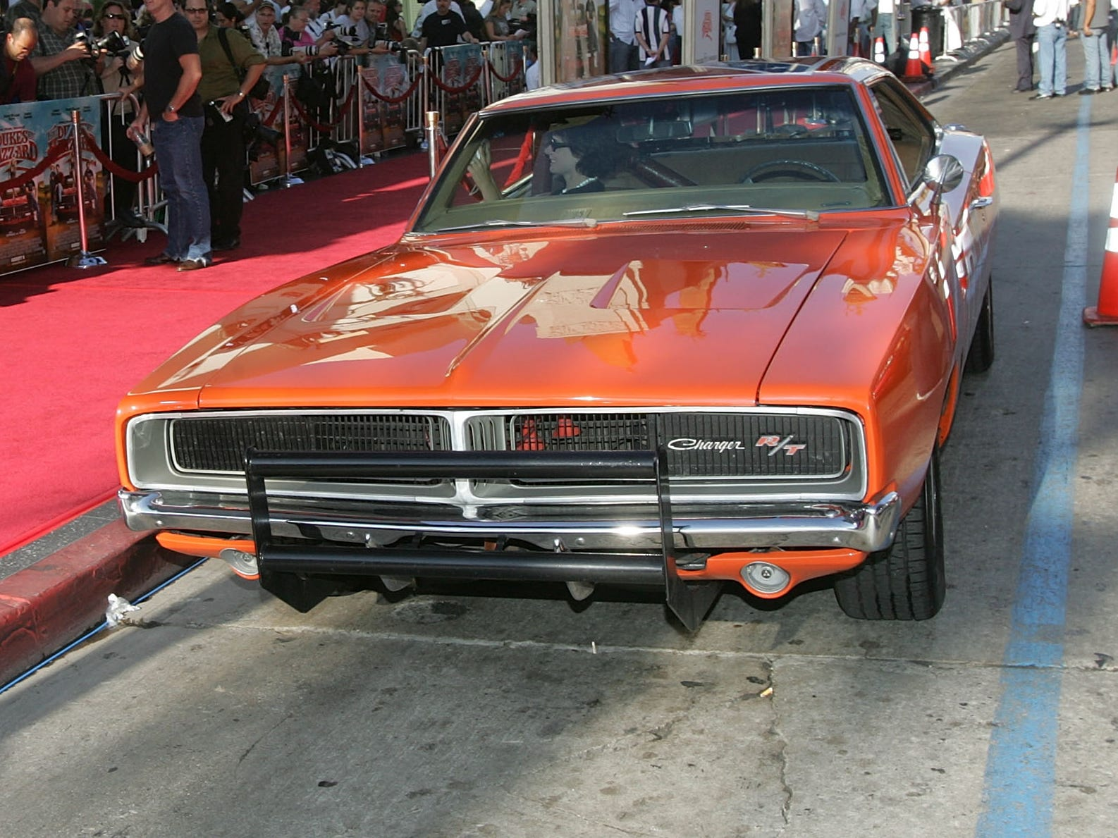 """HOLLYWOOD , CA - JULY 28:  The """"General Lee"""", a 1969 Dodge Charger muscle car arrives at the Premiere Of """"The Dukes of Hazzard"""" at the Grauman's Chinese Theatre on July 28, 2005 in Hollywood, California. (Photo by Kevin Winter/Getty Images)"""