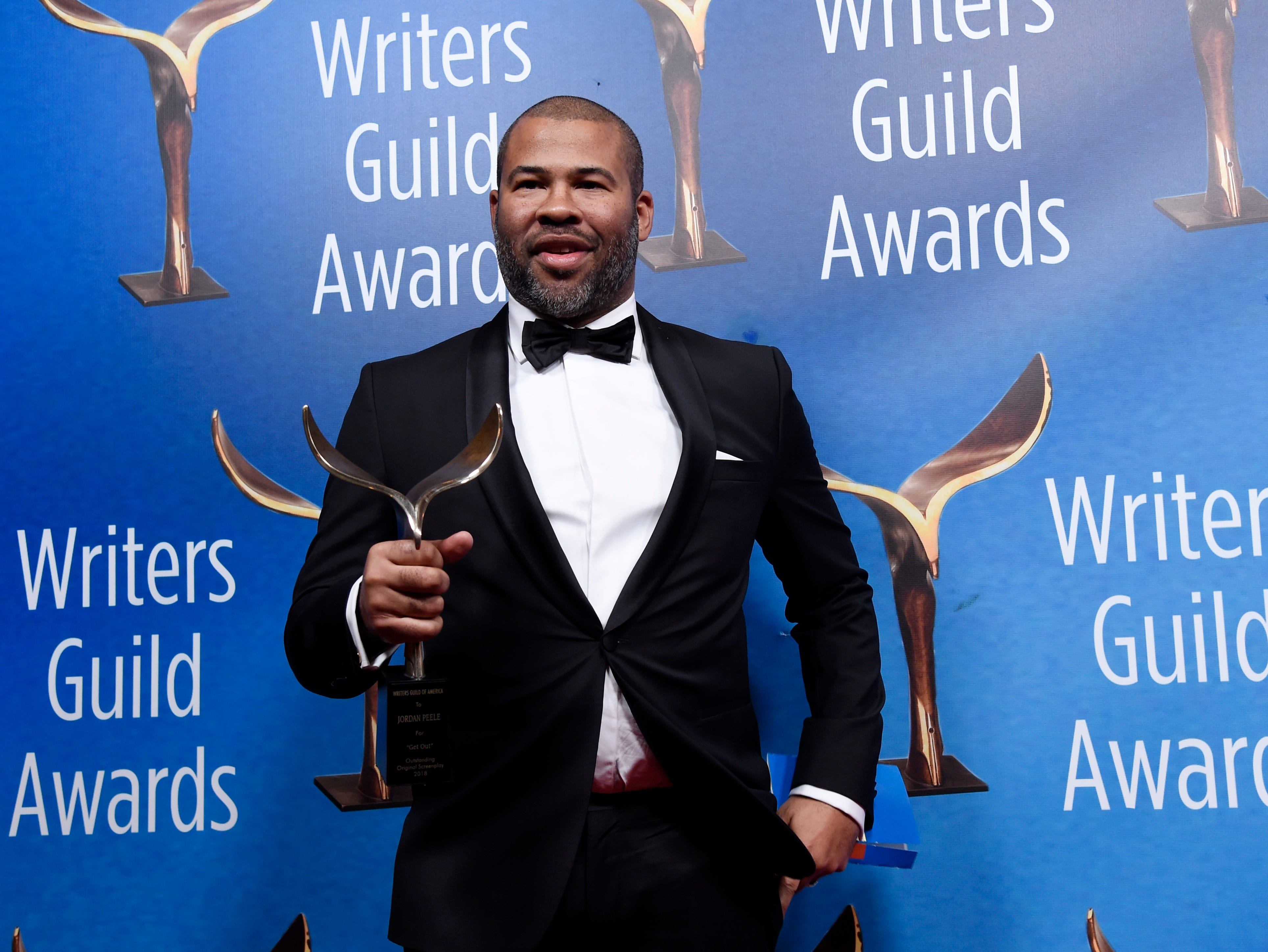 """Feb. 11: """"Get Out"""" writer/director Jordan Peele shows off his original-screenplay award at the Writers Guild Awards in Beverly Hills, California."""