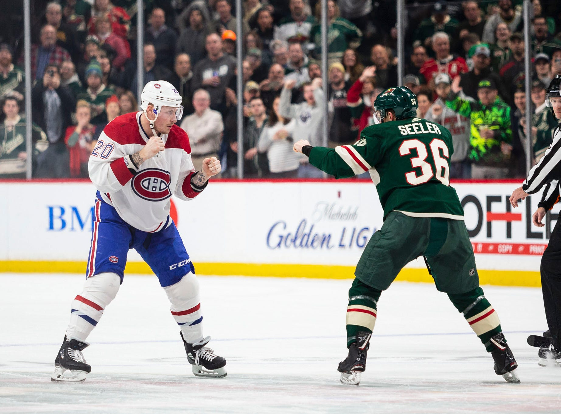 Dec. 11: Montreal Canadiens' Nicolas Deslauriers vs. Minnesota Wild's Nick Seeler.