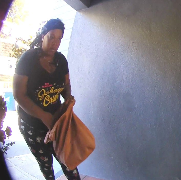 A woman stealing a package at the San Francisco home of John Priskorn. She was later arrested and convicted with second-degree burglary after neighbors pooled video footage to find her license plate number, allowing police to track her down.