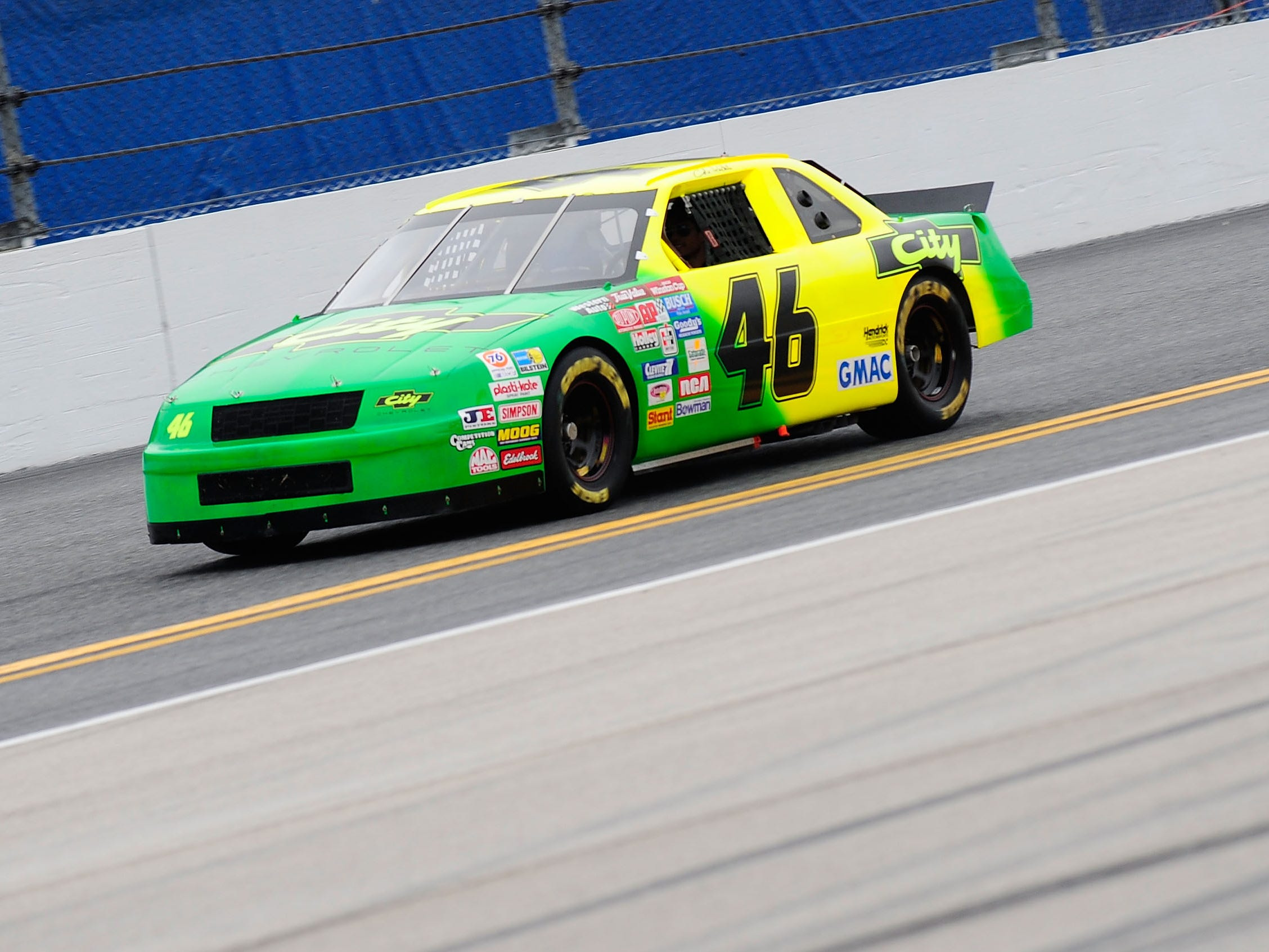 """DAYTONA BEACH, FL - FEBRUARY 15:  Actor Tom Cruise drives the car used in the film """"Days of Thunder"""" on track prior to the NASCAR Sprint Cup Series Daytona 500 at Daytona International Speedway on February 15, 2009 in Daytona Beach, Florida.  (Photo by Rusty Jarrett/Getty Images for NASCAR)"""