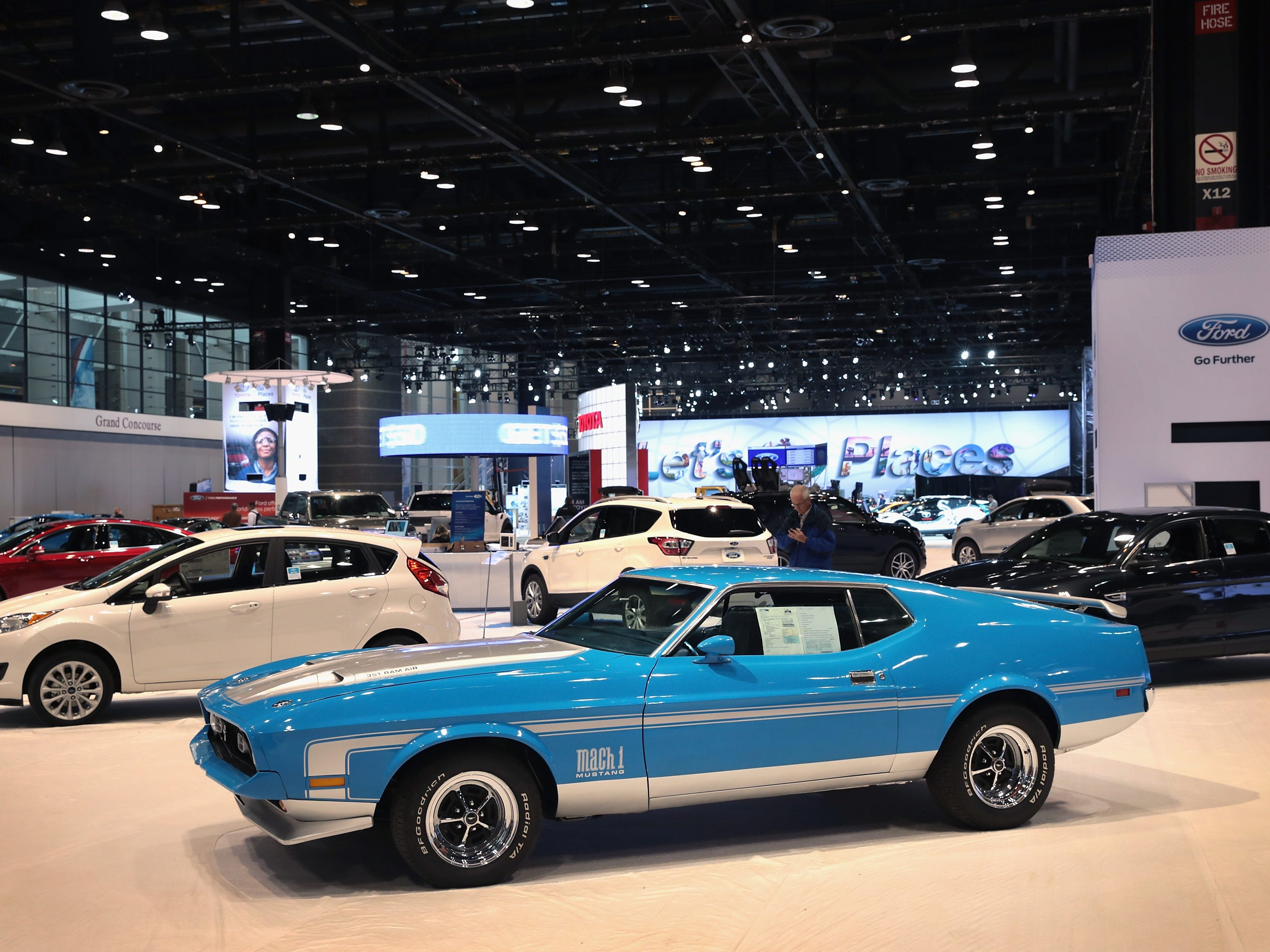CHICAGO, IL - FEBRUARY 08:  A 1971 Mustang Mach 1 sits among new ford vehicles as workers prepare the floor for the opening of the Chicago Auto Show on February 8, 2017 in Chicago, Illinois.  The auto show, which is the nation's largest, is open to the public February 11-20.  (Photo by Scott Olson/Getty Images) ORG XMIT: 1000003504 ORIG FILE ID: 634281504