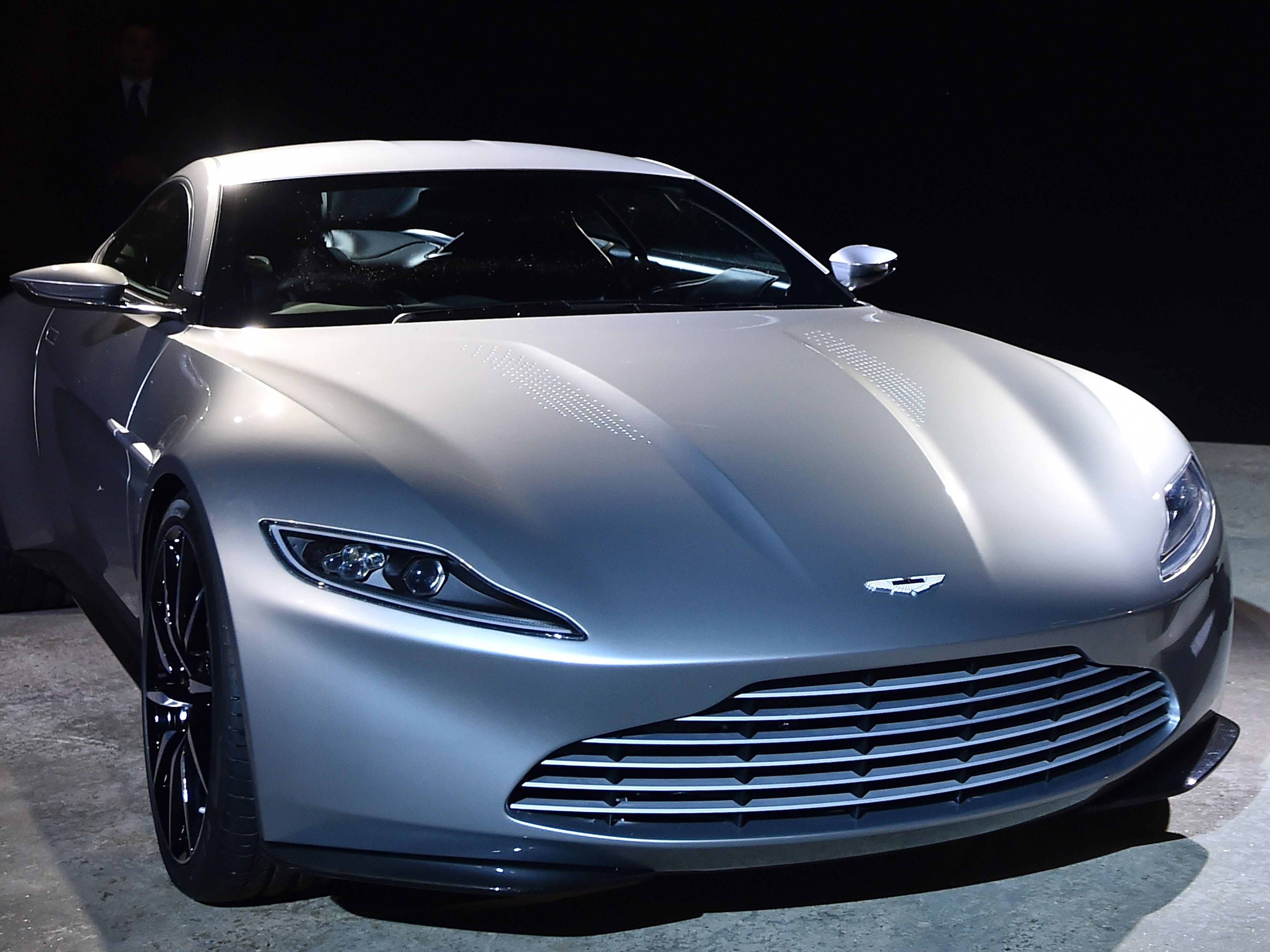 The new Bond car, an Aston Martin DB10, is seen during an event to launch the 24th James Bond film 'Spectre' at Pinewood Studios at Iver Heath in Buckinghamshire, west of London, on December 4, 2014. French actress Lea Seydoux and Italian star Monica Bellucci will star alongside Britain's Daniel Craig in the new James Bond film 'Spectre', the producers said on December 4 at the historic Pinewood Studios. AFP PHOTO / BEN STANSALLBEN STANSALL/AFP/Getty Images ORG XMIT: 6484 ORIG FILE ID: 535880402