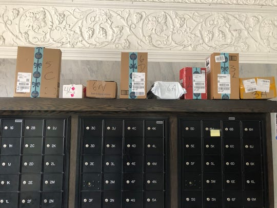 Packages waiting for their recipients to pick them up at a New York City apartment building. Despite having a locked door to the outside, package thieves have several times been able to talk their way into the building and make off with all the packages.