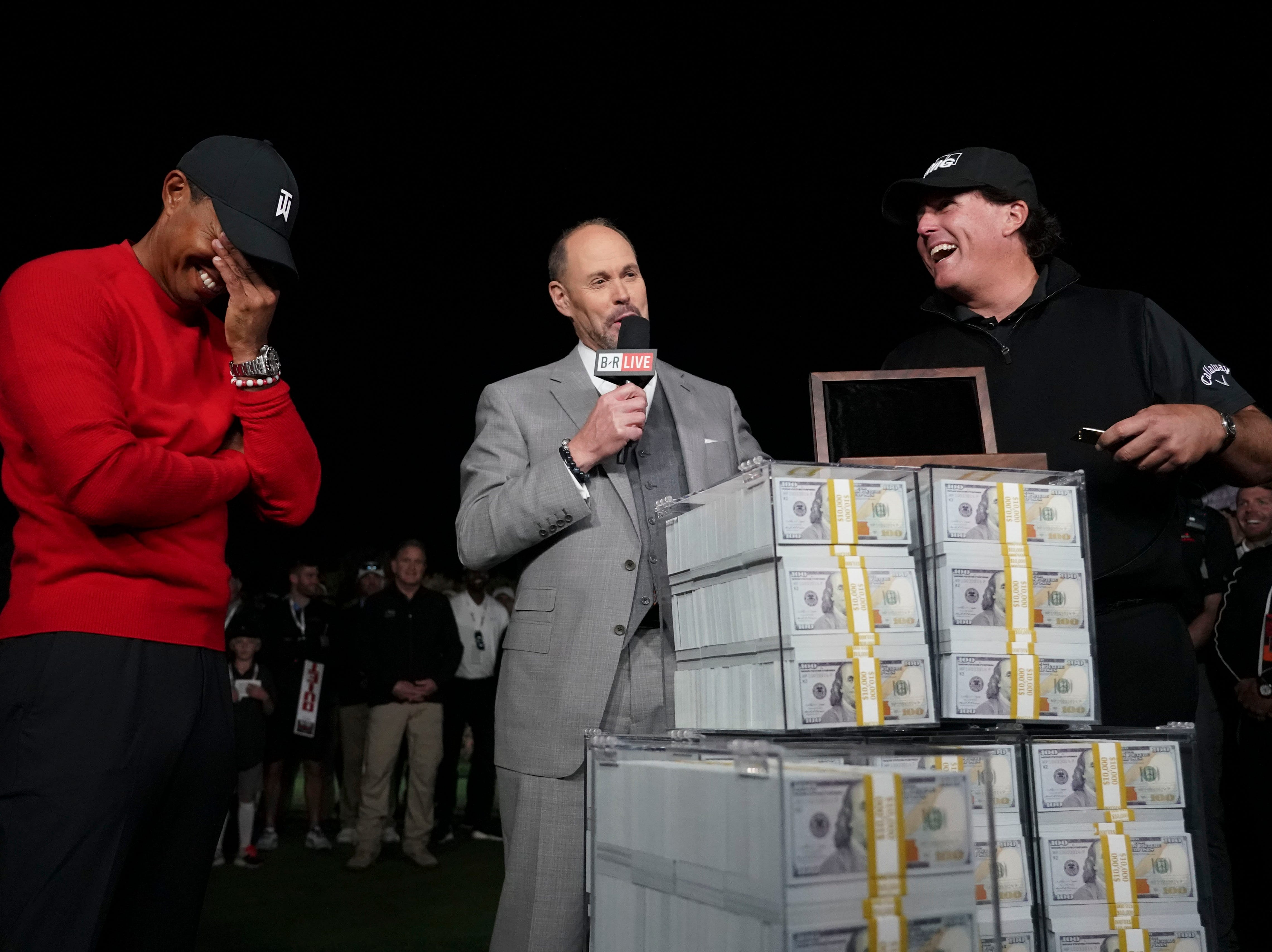 Nov. 23: Phil Mickelson reacts after the winner's belt didn't fit as Tiger Woods looks on after The Match.
