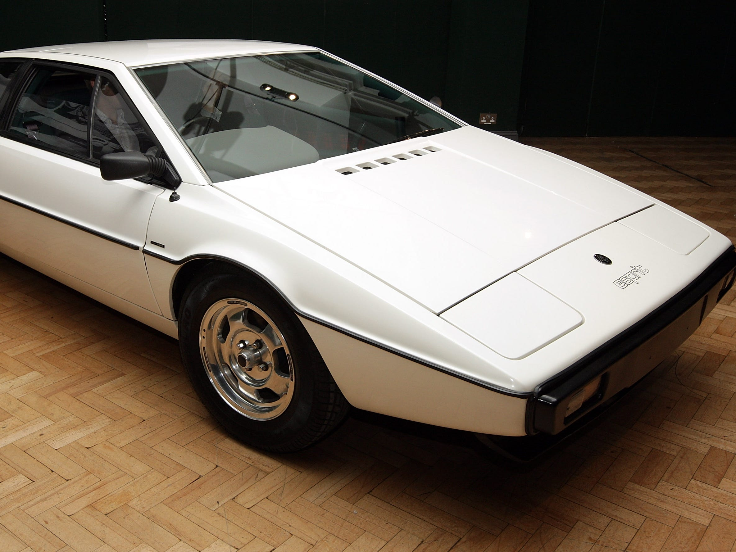 LONDON - NOVEMBER 13:  The white 1976 Lotus Esprit car from the 1977 film ' The Spy Who Loved Me ' is displayed on November 13, 2008 in London, England. The classic car is set to be auctioned in Bonhams' annual motoring sale at Olympia, West London on December 1, 2008 and is expected to fetch up to £120,000.  (Photo by Oli Scarff/Getty Images) ORG XMIT: 83674447 [Via MerlinFTP Drop]