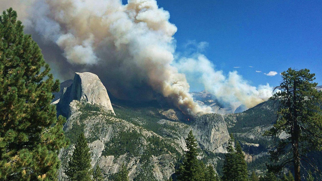 The Meadow Fire in Yosemite National Park on Sept. 7, 2014. Half Dome is on the left, with a smoke plume rising from Little Yosemite Valley to its right.