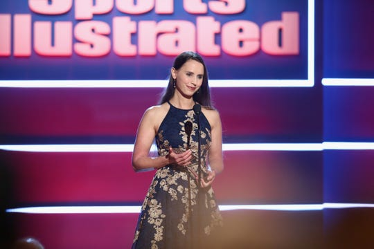 """Rachael Denhollander accepts the """"Inspiration of the Year Award"""" onstage at Sports Illustrated 2018 Sportsperson of the Year Awards Show on December 11, 2018 at The Beverly Hilton in Los Angeles."""