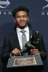 Oklahoma Sooners quarterback Kyler Murray with the Heisman Trophy.