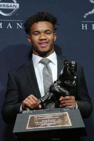 Oklahoma Sooners quarterback Kyler Murray with the Heisman Trophy.