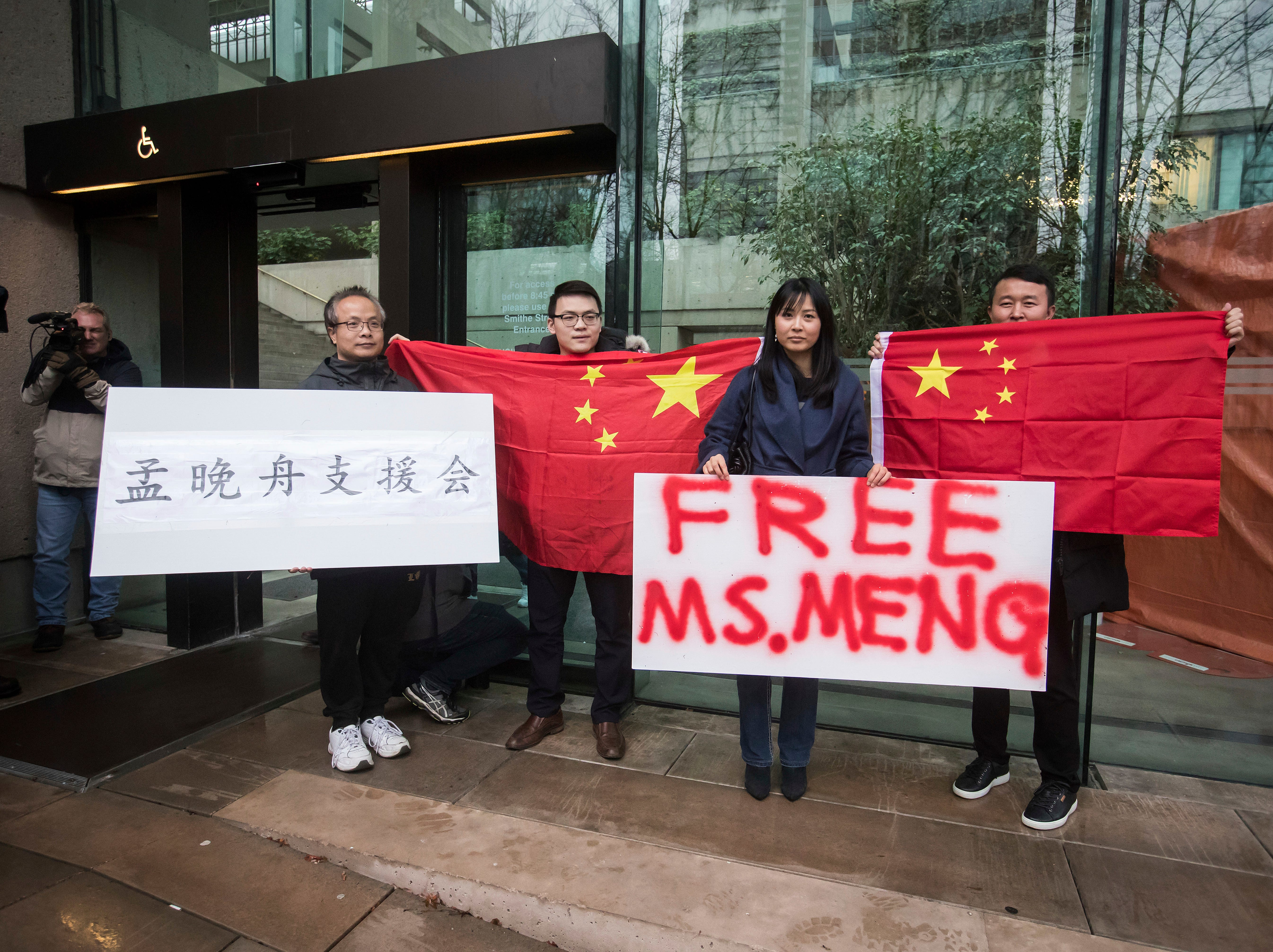 Chinese citizens celebrate after Huawei executive Meng Wanzhou is released in Canada