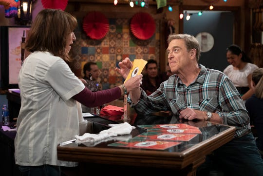 Guest star Katey Sagal, left, plays a longtime friend who flirts with widower Dan (John Goodman) on Tuesday's fall finale of 'The Conners.'