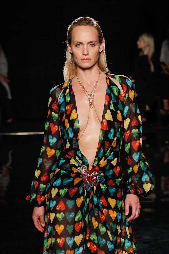 Amber Valletta walks the runway at the Versace Pre-Fall 2019 Collection wearing a familiar design.