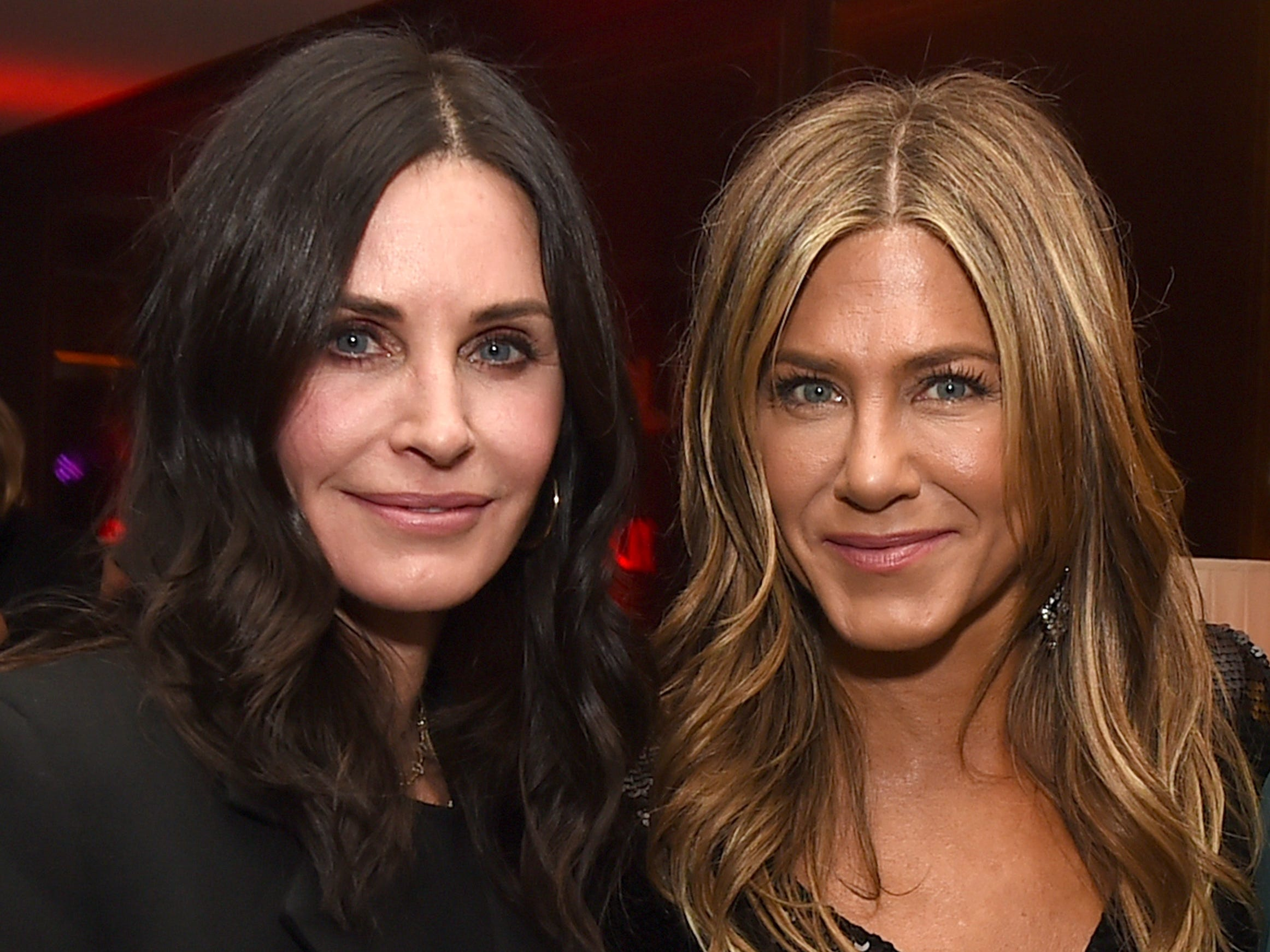 """LOS ANGELES, CA - DECEMBER 06:  Courteney Cox (L) and Jennifer Aniston pose at the after party for the premiere of Netflix's """"Dumplin'"""" at Sunset Tower on December 6, 2018 in Los Angeles, California.  (Photo by Kevin Winter/Getty Images) ORG XMIT: 775264140 ORIG FILE ID: 1069334698"""