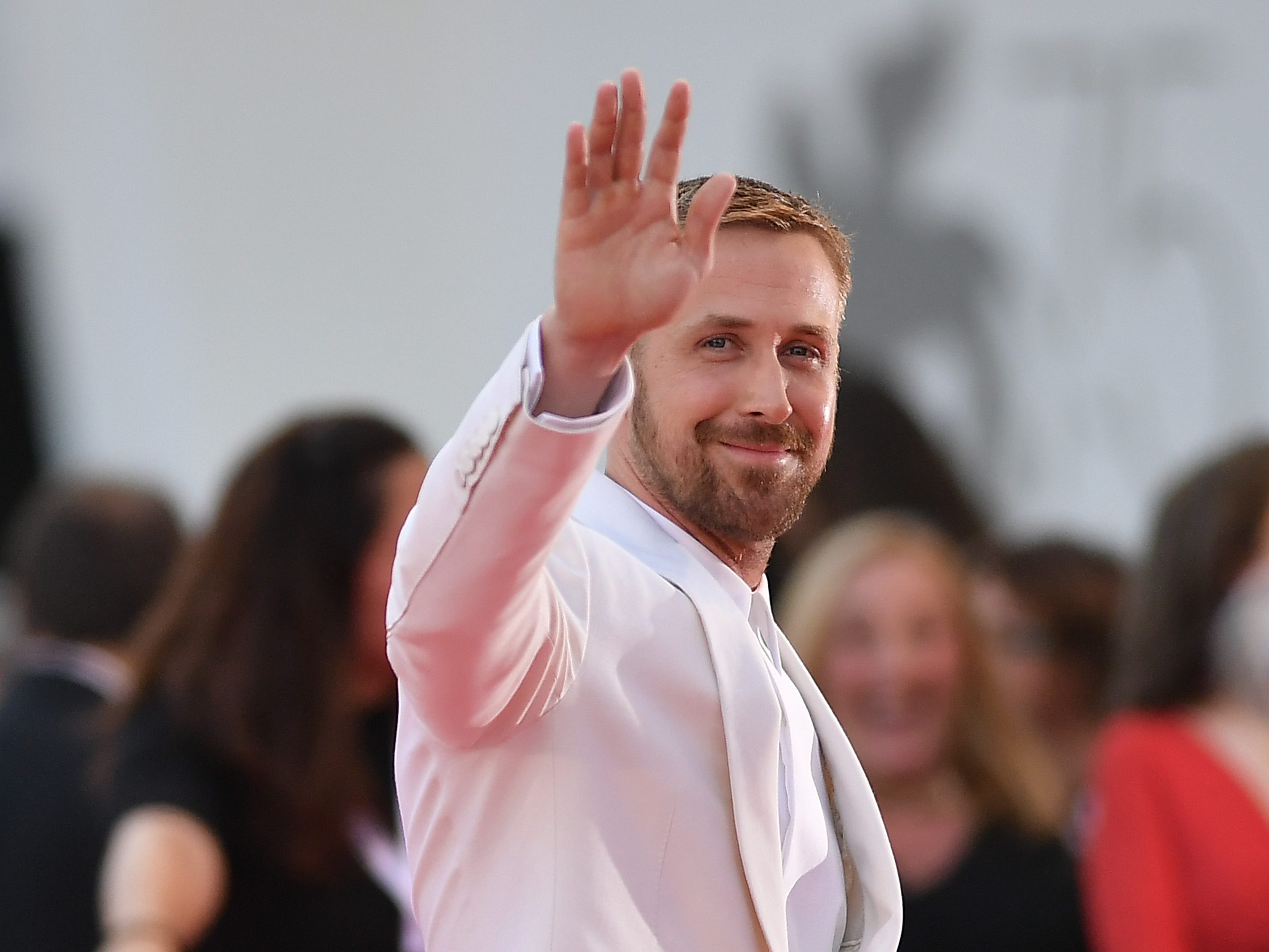 """August 29: Ryan Gosling poses on the red carpet for """"First Man"""" screening at the Venice Film Festival."""