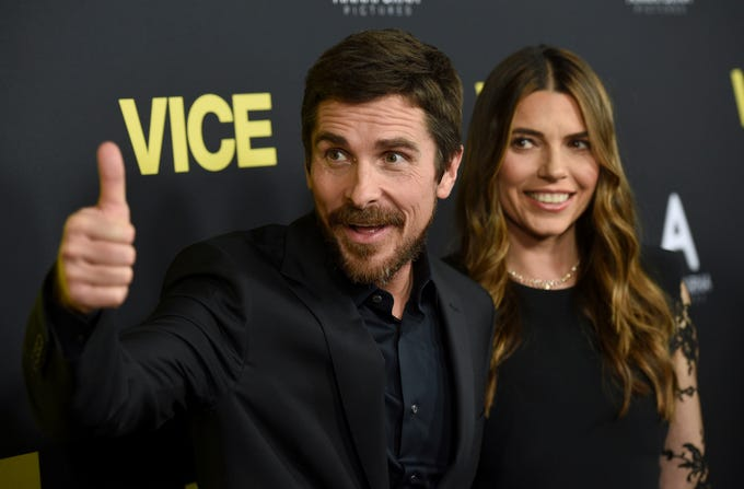 """Christian Bale, left, and Sibi Blazic arrive at the world premiere of """"Vice"""" on Tuesday, Dec. 11, 2018, at the Samuel Goldwyn Theater in Beverly Hills, Calif. (Photo by Chris Pizzello/Invision/AP) ORG XMIT: CAPM117"""