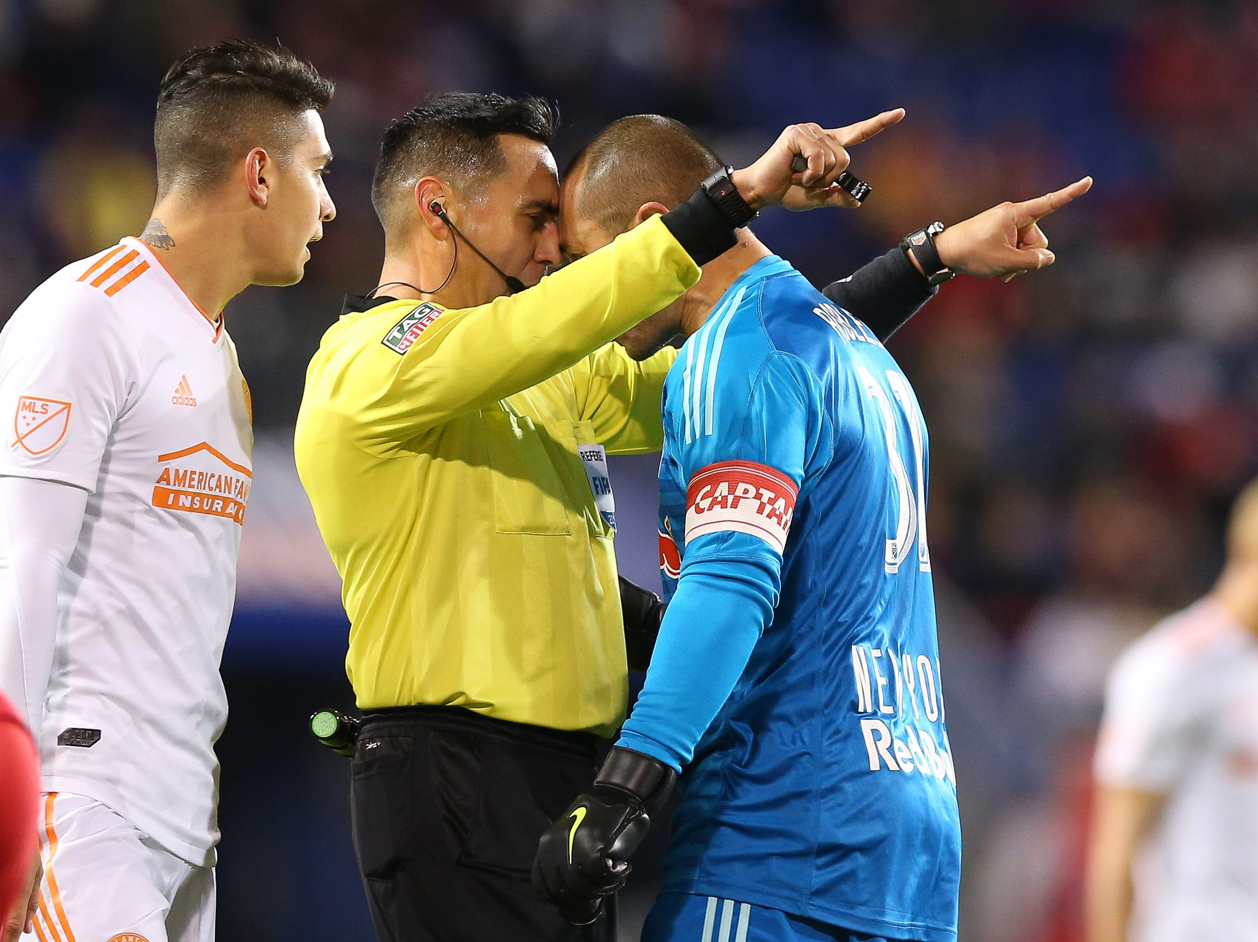 Nov. 29: New York Red Bulls goalkeeper Luis Robles (31) argues with referee Jair Antonio Marrufo during the first half of the second leg of the MLS Eastern Conference championship at Red Bull Arena.