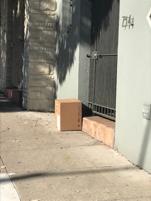 A package delivered to a home in San Francisco and left in front of the door.