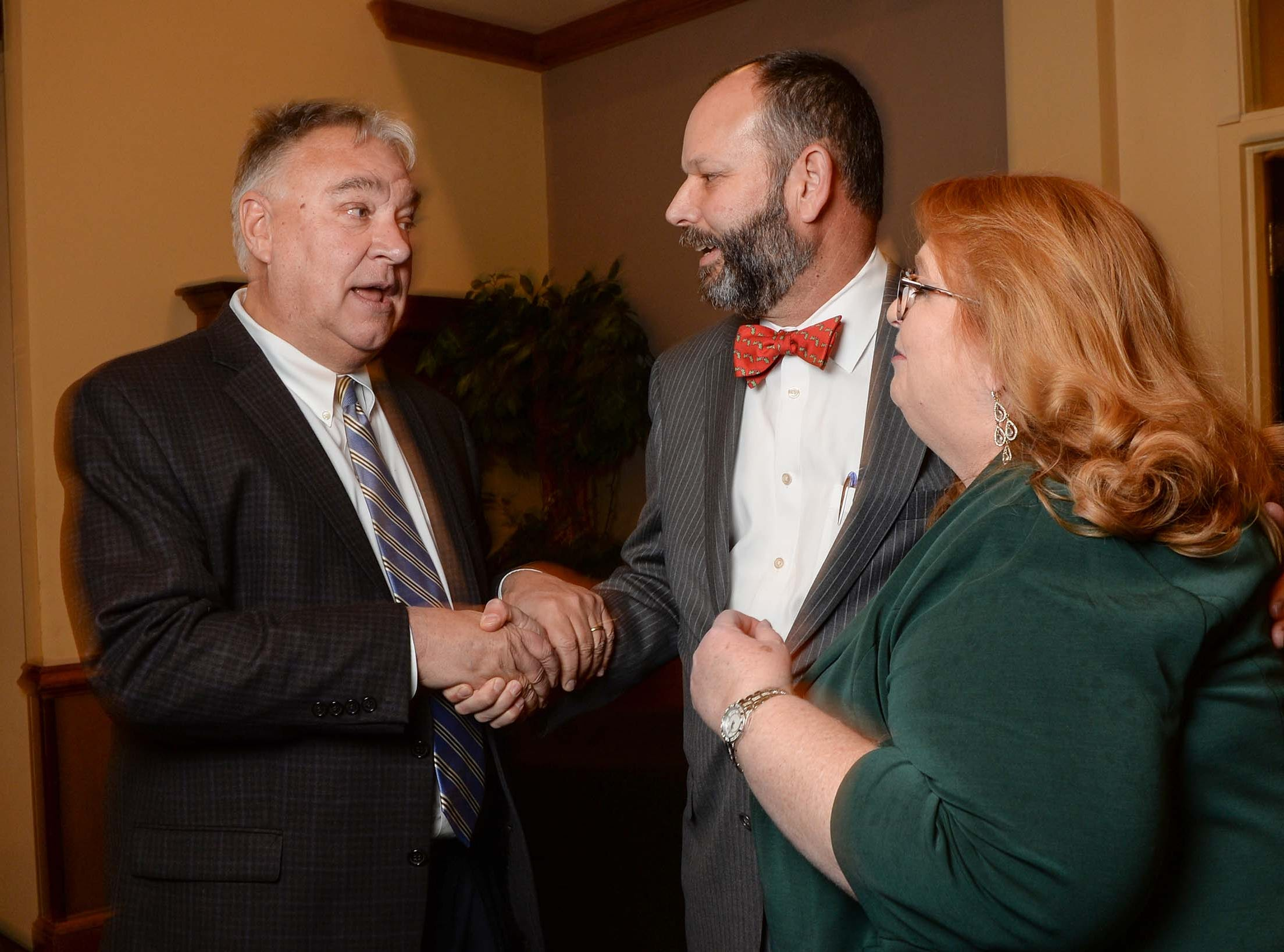 Rusty Burns, left, Anderson County Administrator, talks with State Rep. Brian White before he was presented the 2017-2018 Business Champion Award during the chamber lunch at Tucker's in Anderson Thursday, December 13, 2018. President and CEO Pamela Christopher of the Anderson Area Chamber of Commerce is on the right.