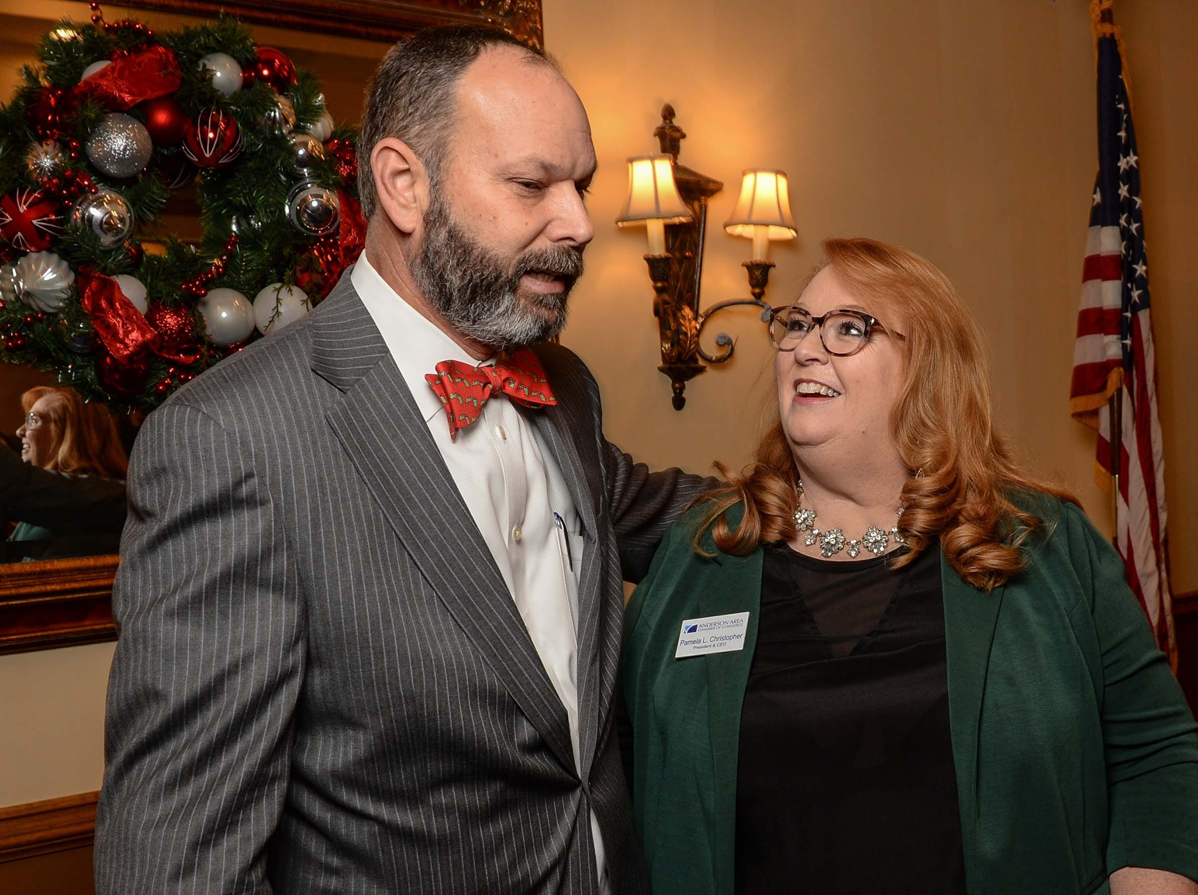 State Rep. Brian White was presented the 2017-2018 Business Champion Award during the chamber lunch at Tucker's in Anderson Thursday, December 13, 2018. President and CEO Pamela Christopher, right, of the Anderson Area Chamber of Commerce.