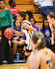 TL Hanna junior Maleia Bracone dribbles by Wren coach Pam McGowens during the second quarter at TL Hanna High School in Anderson on Wednesday.