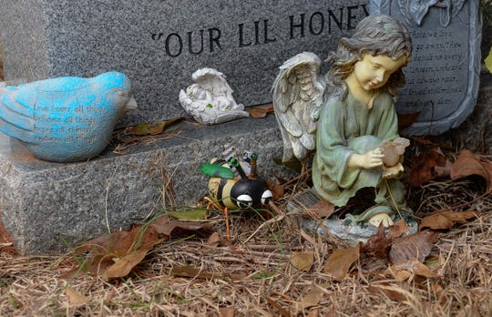 An angel marks the grave of baby Gwynne Hess, which is in a cemetery near the First Baptist Church in Westminster.