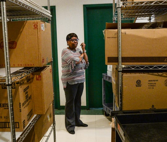 Adraine Jackson-Garner, executive director of the Littlejohn Community Center, looks at a full storage area in the building in Clemson on Thursday. The center will receive $500,000 from the Community Development Block Grant program. It is one of 21 South Carolina Department of Commerce grants.