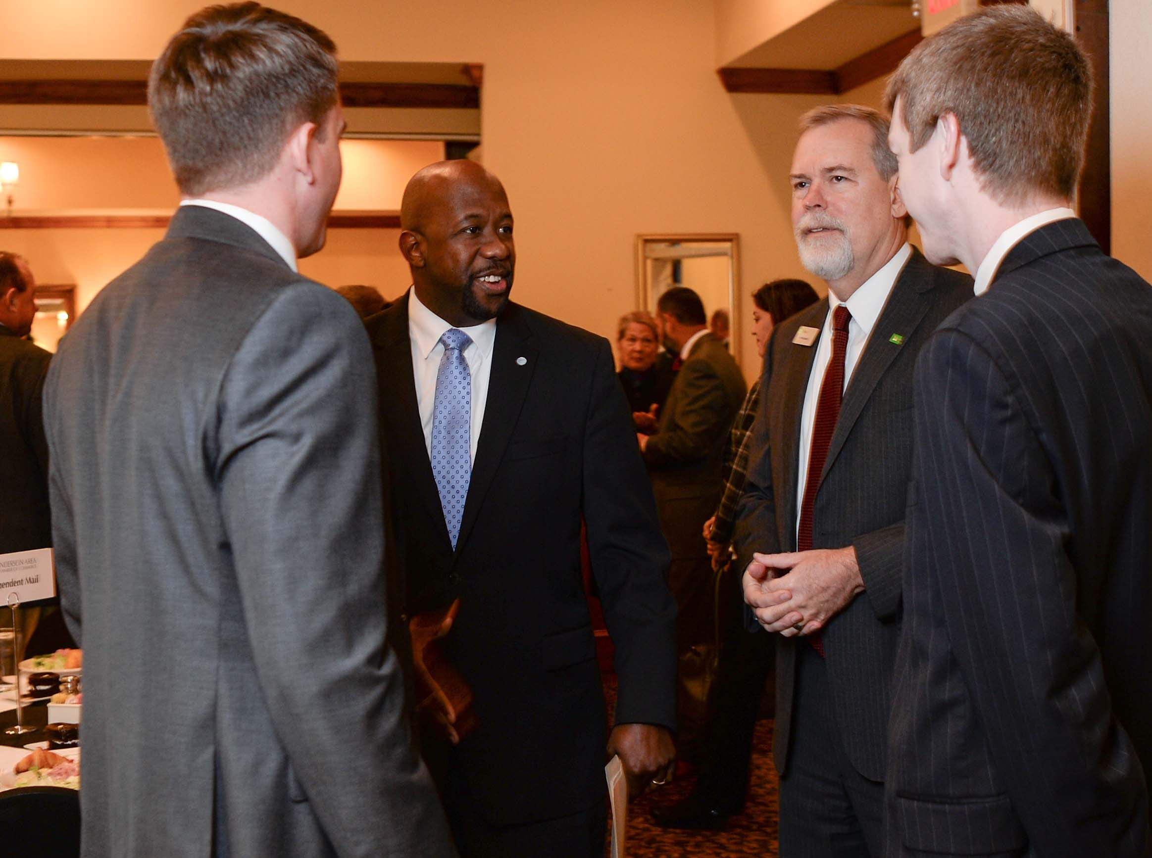 Terrance Ford, middle left, AT&T Director of Legislative Affairs, talks with others before presenting State Rep. Brian White the 2017-2018 Business Champion Award from the Anderson Area Chamber of Commerce at the chamber lunch at Tucker's in Anderson Thursday, December 13, 2018.