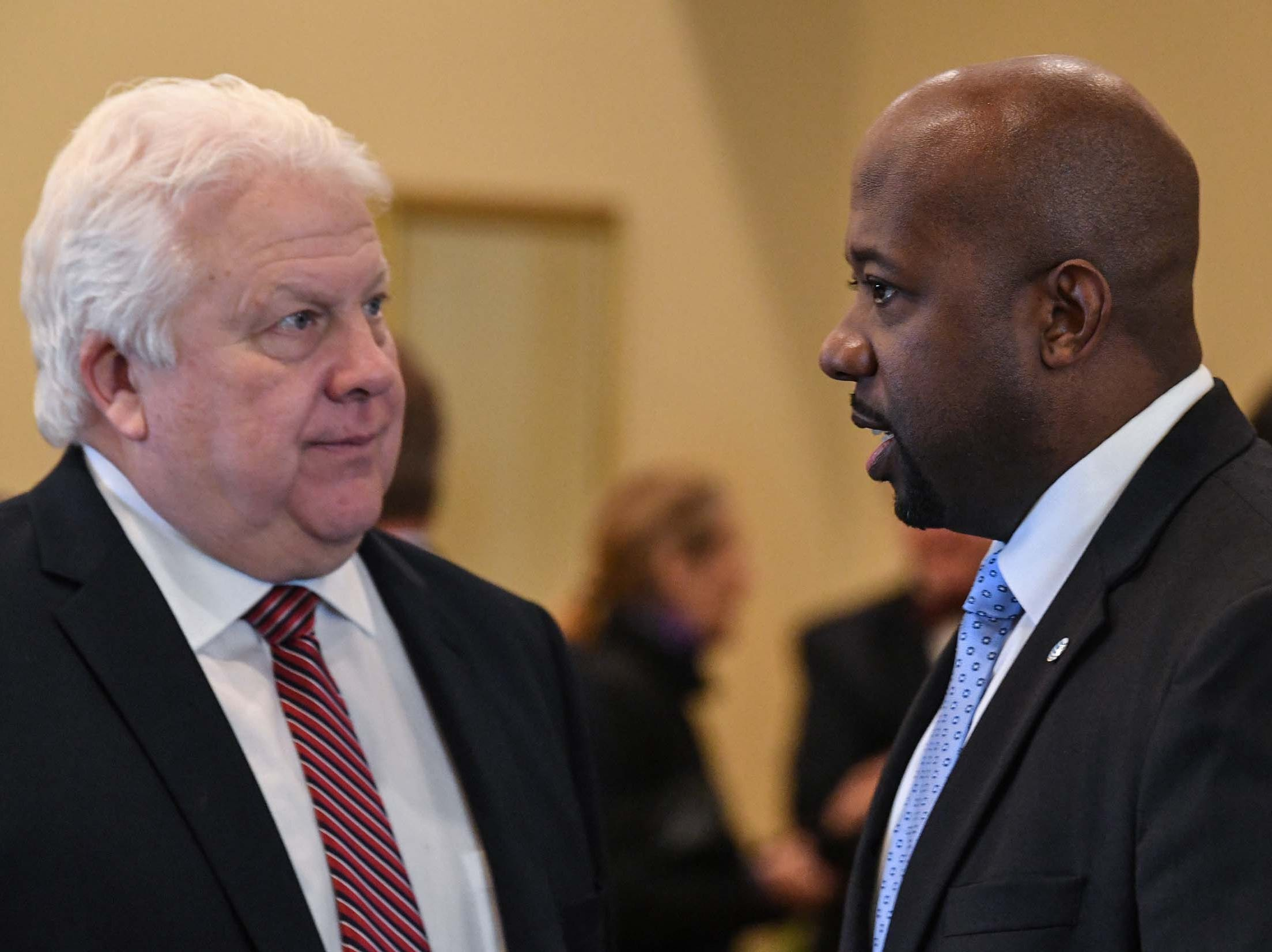 Douglas Wright, left, President/CEO of SENIOR Solutions SC in Anderson, listens to Terrance Ford, middle, AT&T Director of Legislative Affairs, during the chamber lunch at Tucker's in Anderson Thursday, December 13, 2018. Ford presented State Rep. Brian White the 2017-2018 Business Champion Award.