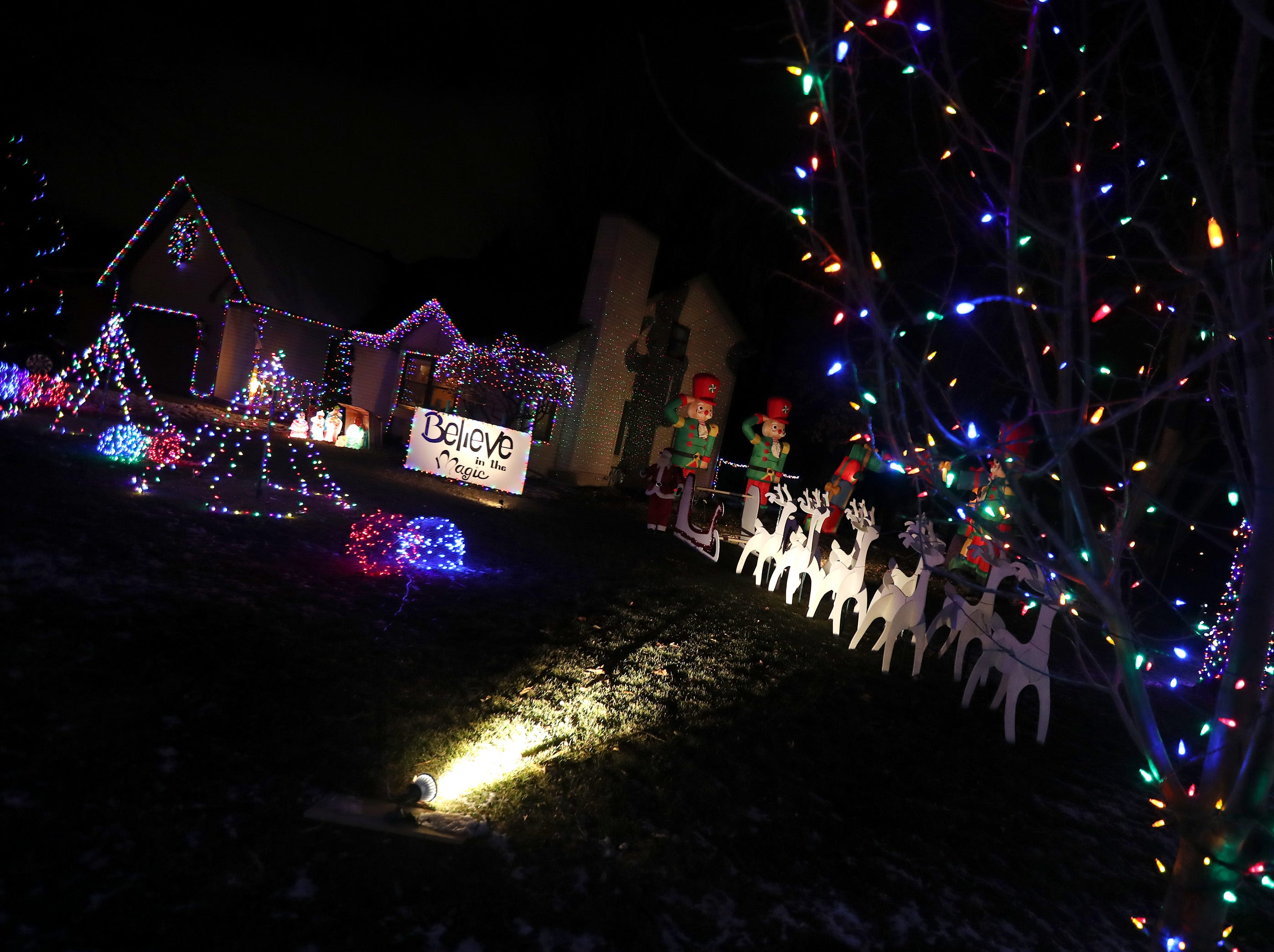 Reindeer cutouts and Christmas lights decorate the yard of a home on the 200 block of Paradise Drive Wednesday Dec. 5, 2018, in Little Chute, Wis.