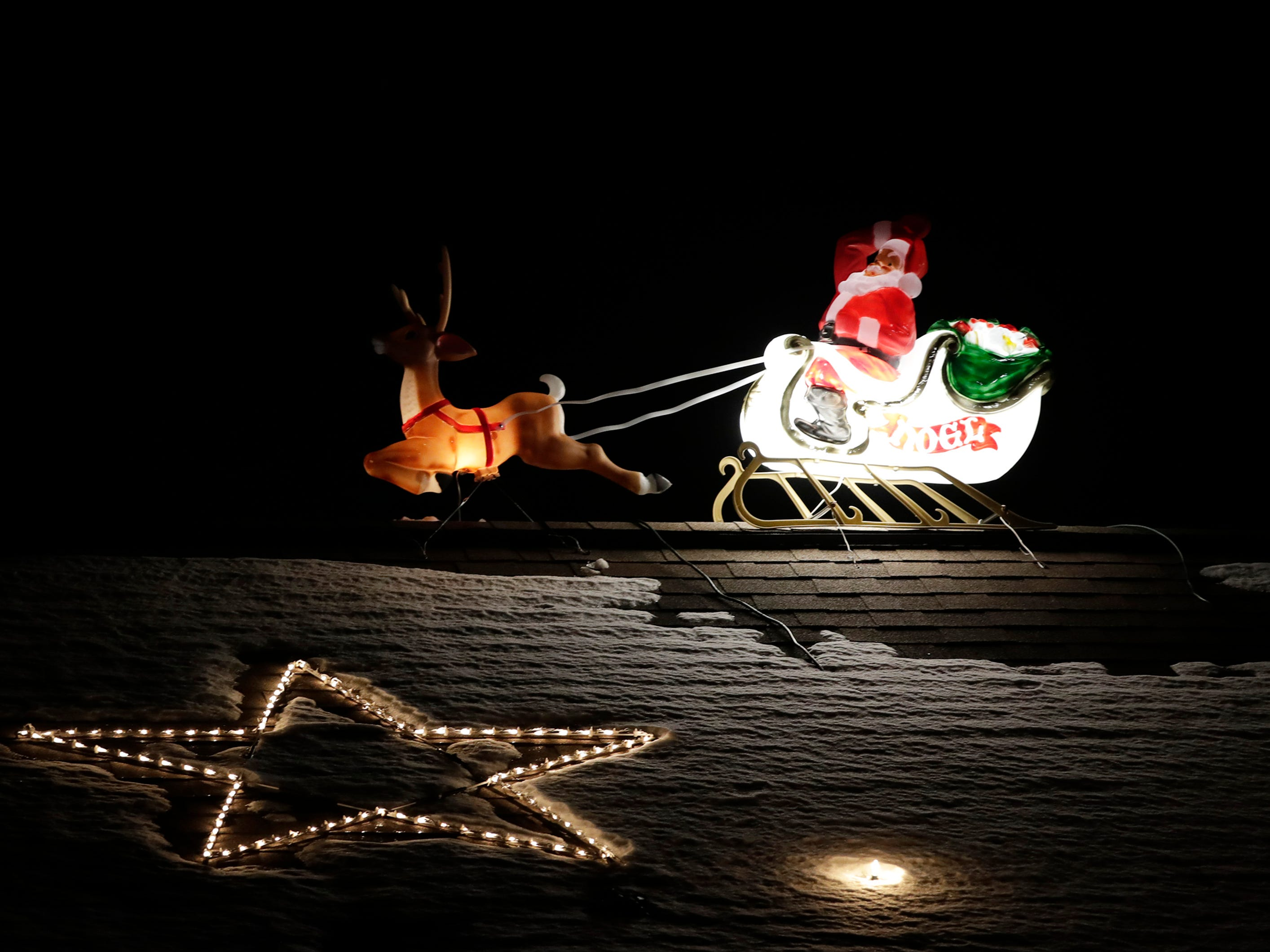 A light up Santa on display at a home on the 9400 block of  Sara Lane Wednesday Dec. 5, 2018, in Darboy, Wis.