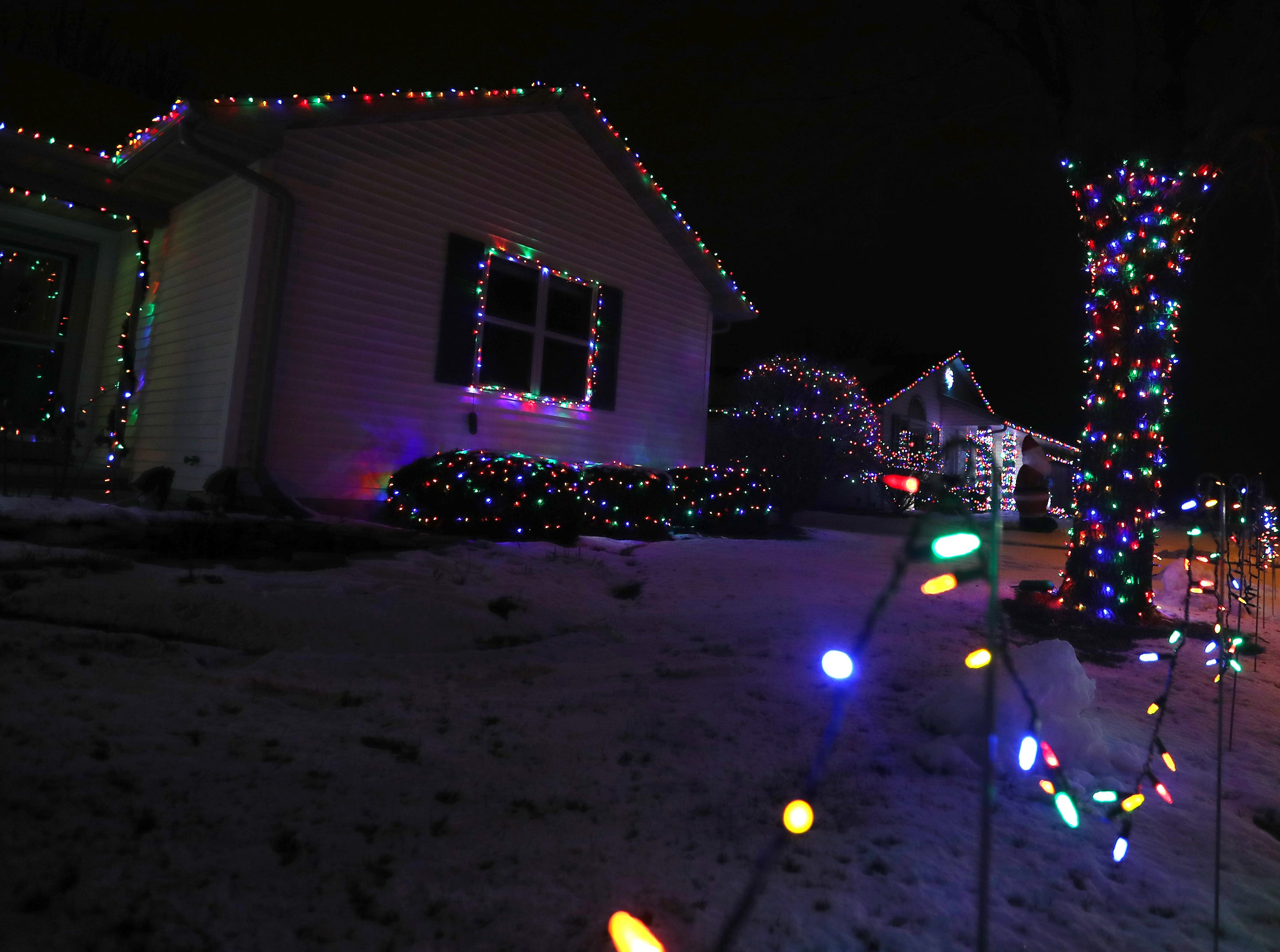 Christmas lights decorate a house on the 3500 block of Fiesta Drive Wednesday Dec. 5, 2018, in Appleton, Wis.
