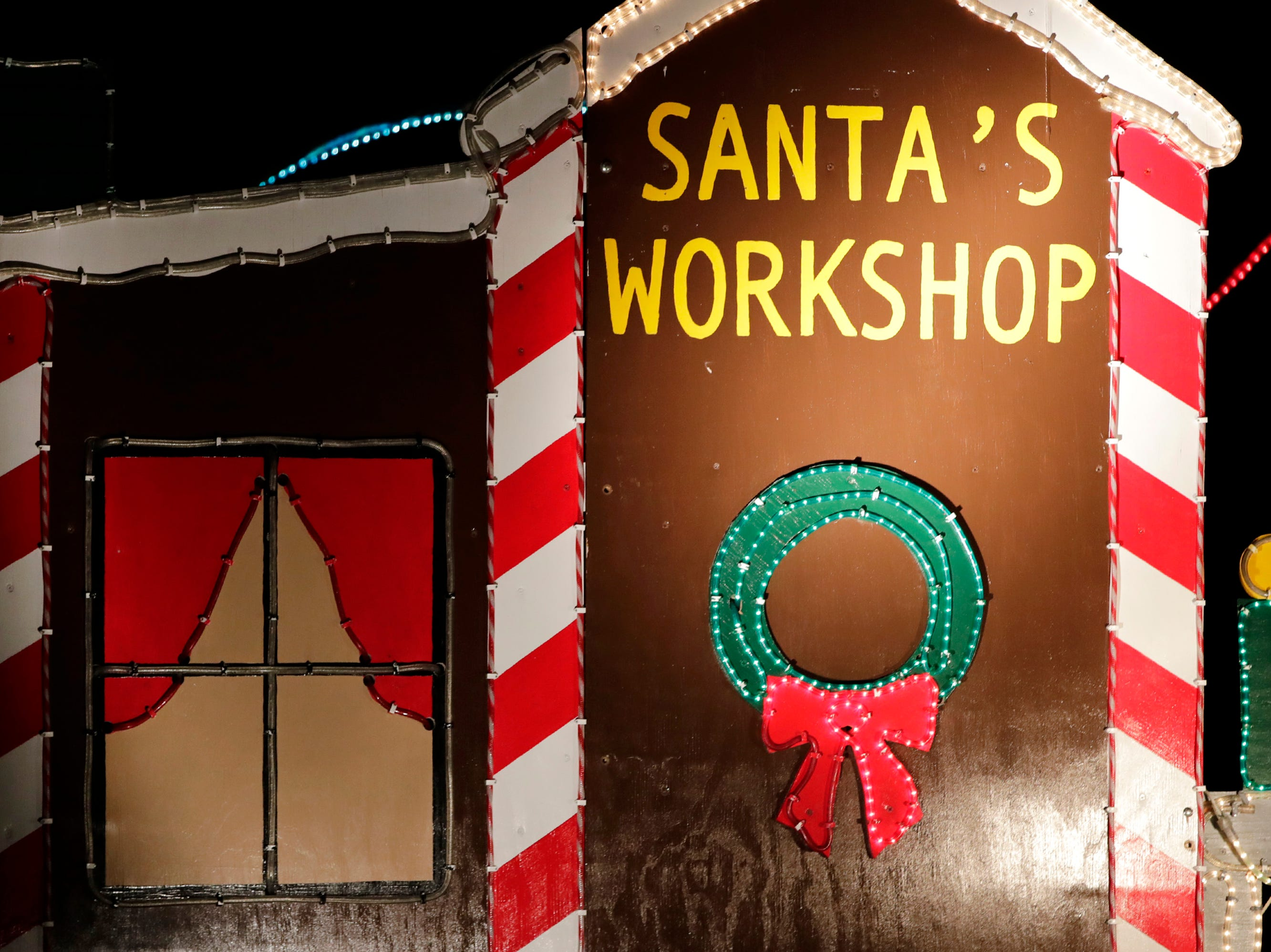 A cutout of Santa's workshop is on display at a home on the 500 block of Janssen Street Wednesday Dec. 5, 2018, in Combined Locks, Wis.